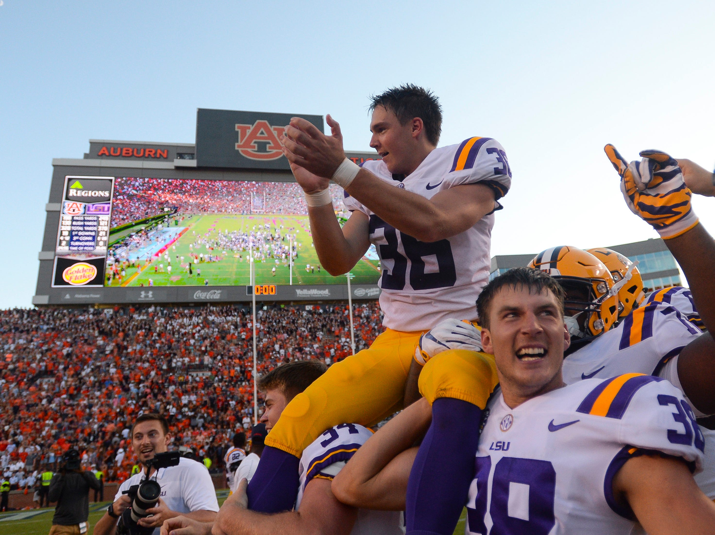 LSU Tigers kicker Cole Tracy (36) celebrates after kicking the game-winning field goal to defeat the Auburn Tigers 22-21 at Jordan-Hare Stadium.