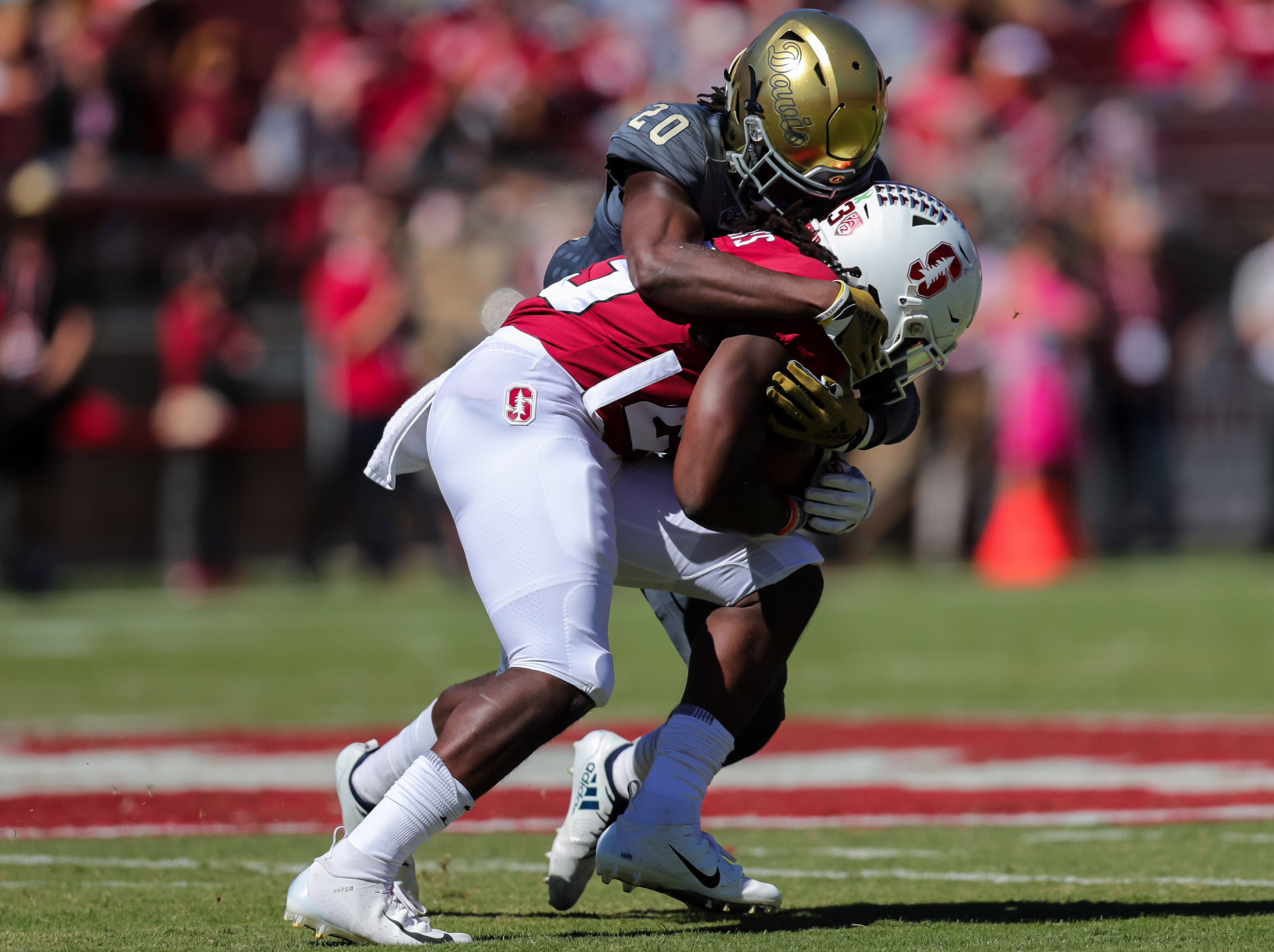 Sep 15, 2018; Stanford, CA, USA; Stanford Cardinal running back Trevor Speights (23) is tackled by UC Davis Aggies defensive back Vincent White (20) during the first quarter at Stanford Stadium. Mandatory Credit: Sergio Estrada-USA TODAY Sports ORG XMIT: USATSI-382190 ORIG FILE ID:  20180915_gav_ea1_143.jpg