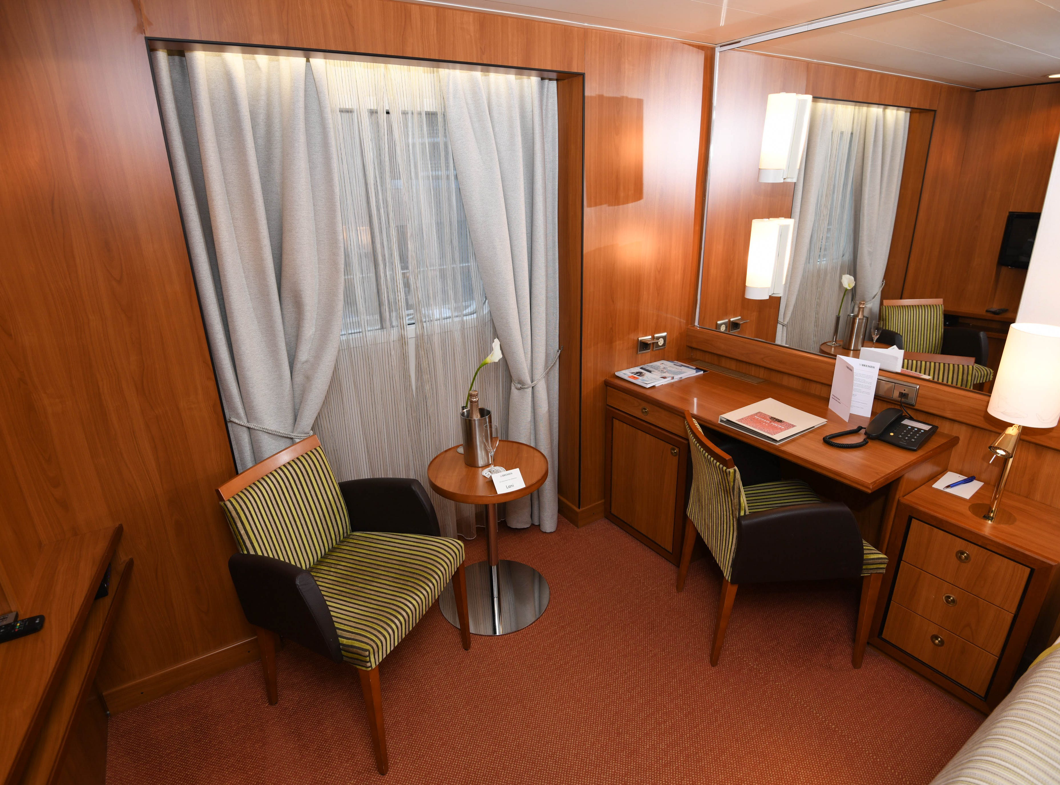 Bremen cabins also feature a desk area with a second chair and side table.