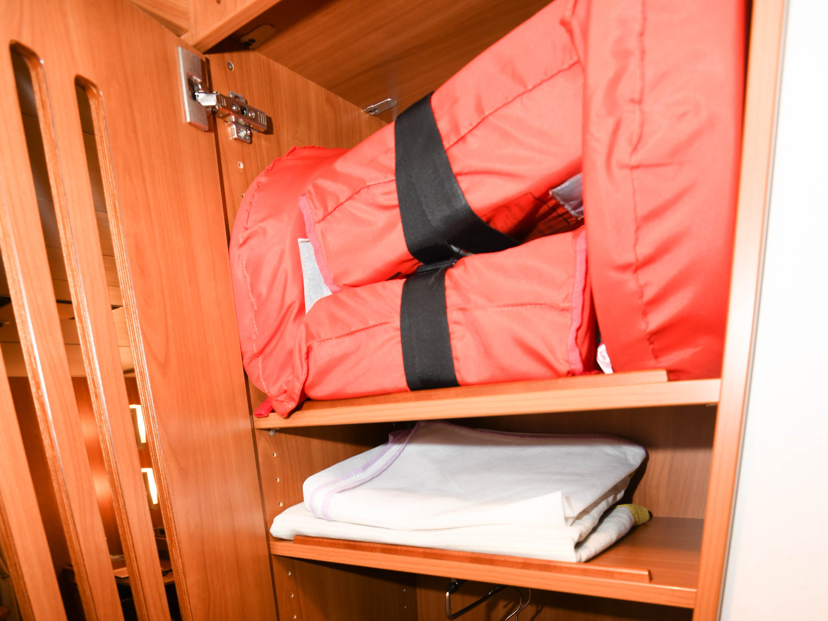 Another built-in closet near the entrance to the cabin is designed to hold life jackets as well as jackets and rubber boots used during Zodiac landings.