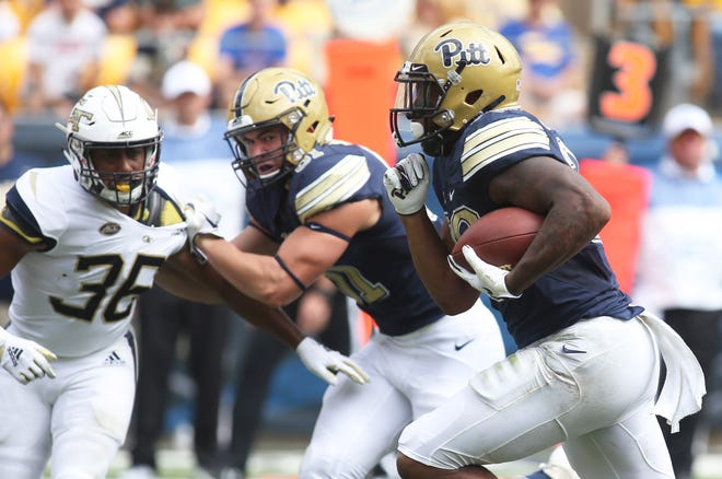 Pittsburgh Panthers running back Qadree Ollison (30) runs for a a 6yard touchdown against the Georgia Tech Yellow Jackets during the second quarter at Heinz Field.