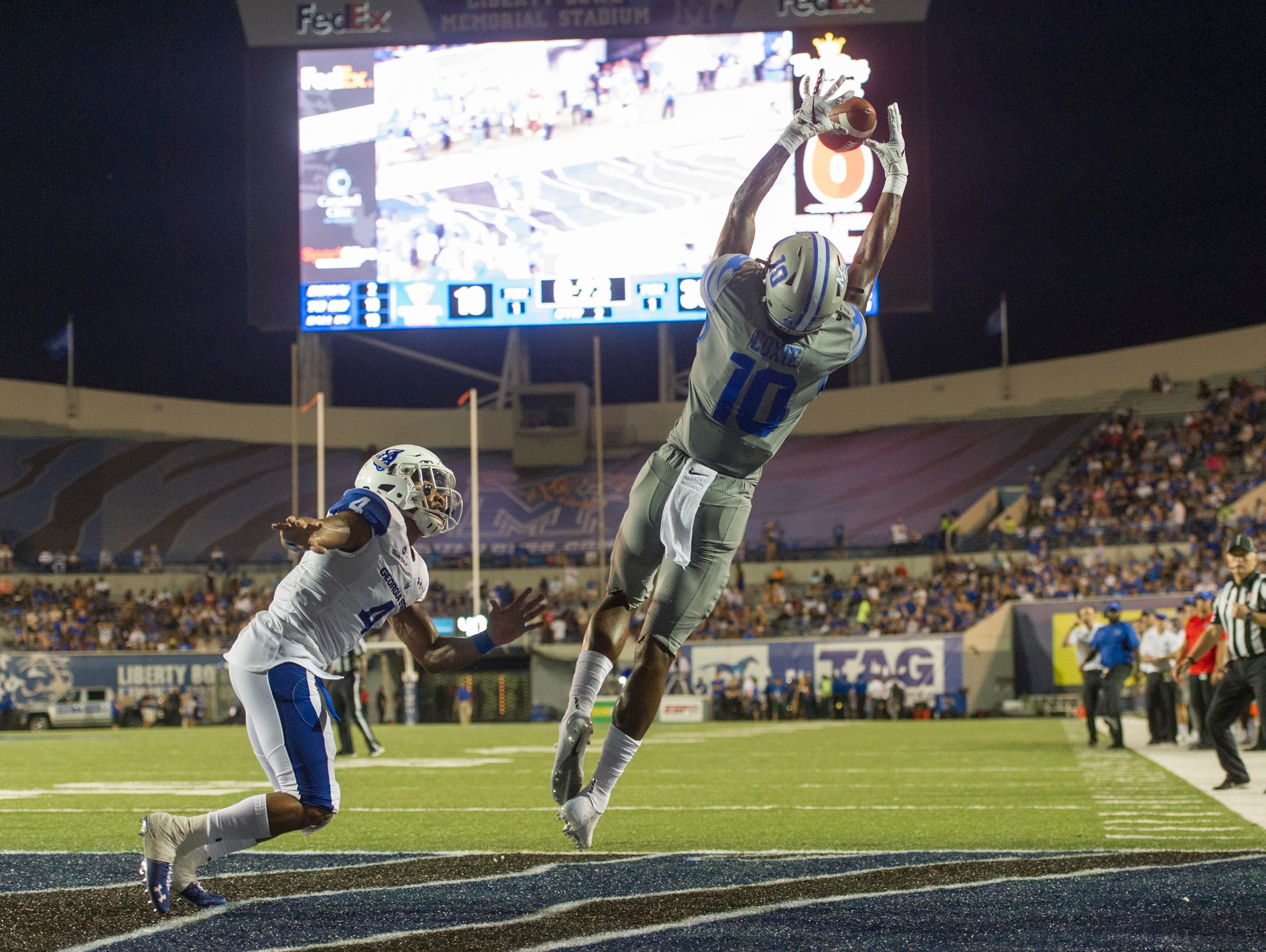Memphis Tigers wide receiver Damonte Coxie (10) attempts to catch a pass against Georgia State Panthers cornerback Khai Anderson (4) during the first half at Liberty Bowl Memorial Stadium.