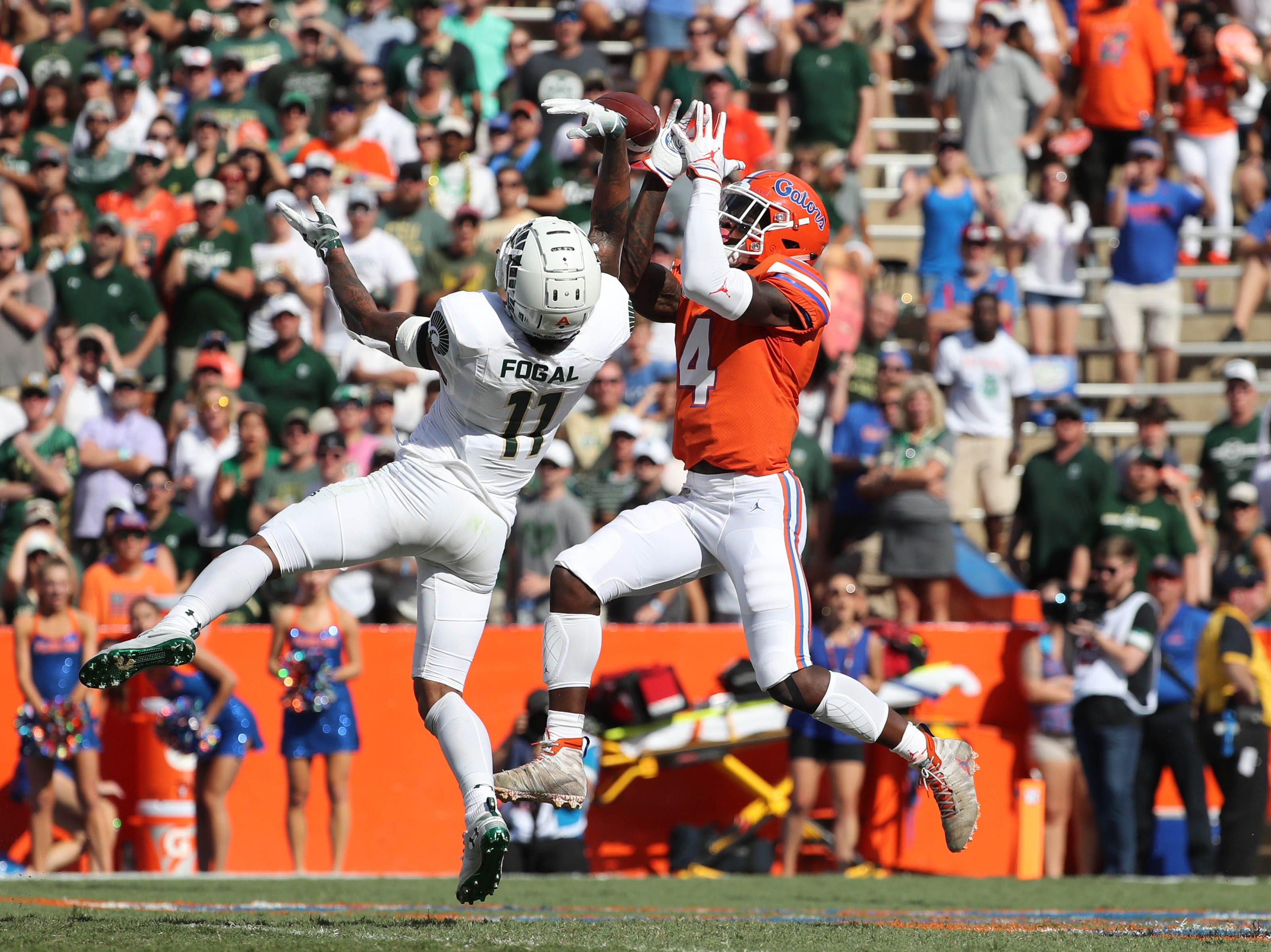 Colorado State Rams safety Jordan Fogal (11) defends against Florida Gators running back Kadarius Toney (4) during the first quarter at Ben Hill Griffin Stadium.