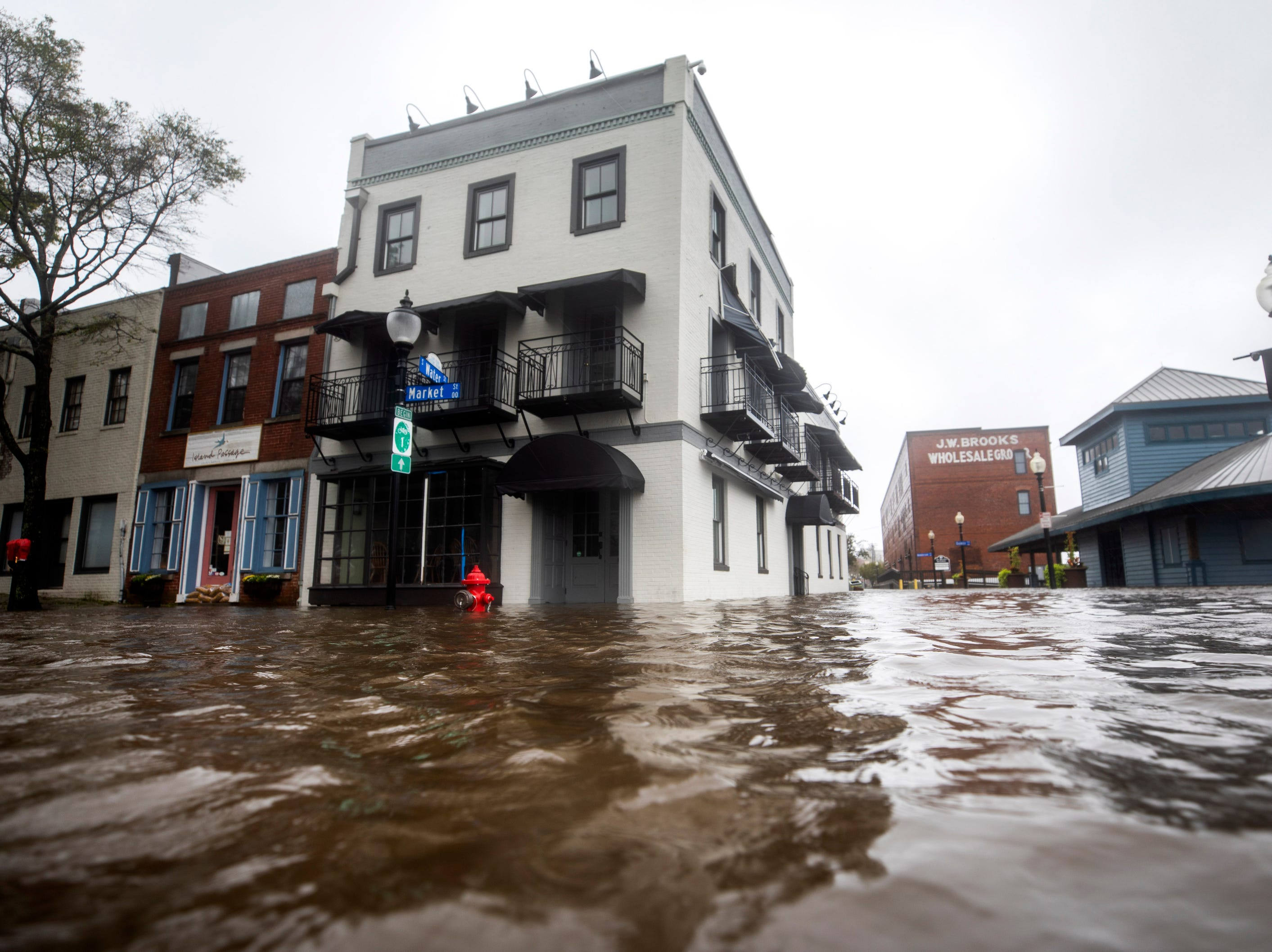 High waters flood Market and Water Streets as Hurricane Florence comes ashore in Wilmington, N.C., Friday afternoon. Hurricane Florence has been downgraded to a tropical storm on the Saffir-Simpson Hurricane Wind Scale, though is still expected to bring a storm surge with heavy flooding to the Carolinas.