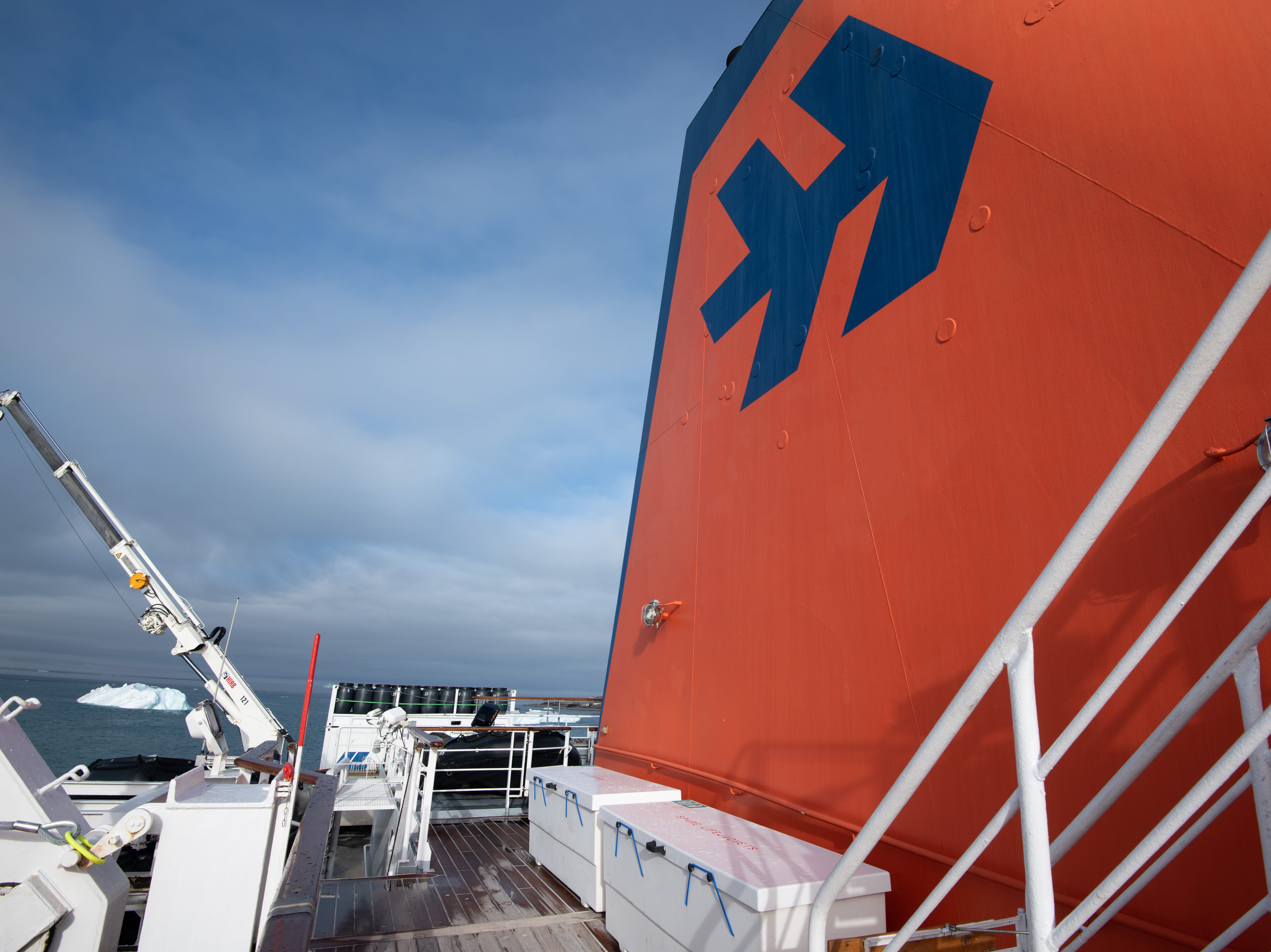 A walkway on Deck 6 bends around Bremen's large orange funnel, offering a view of the crane used to lower Zodiac boats for landings.