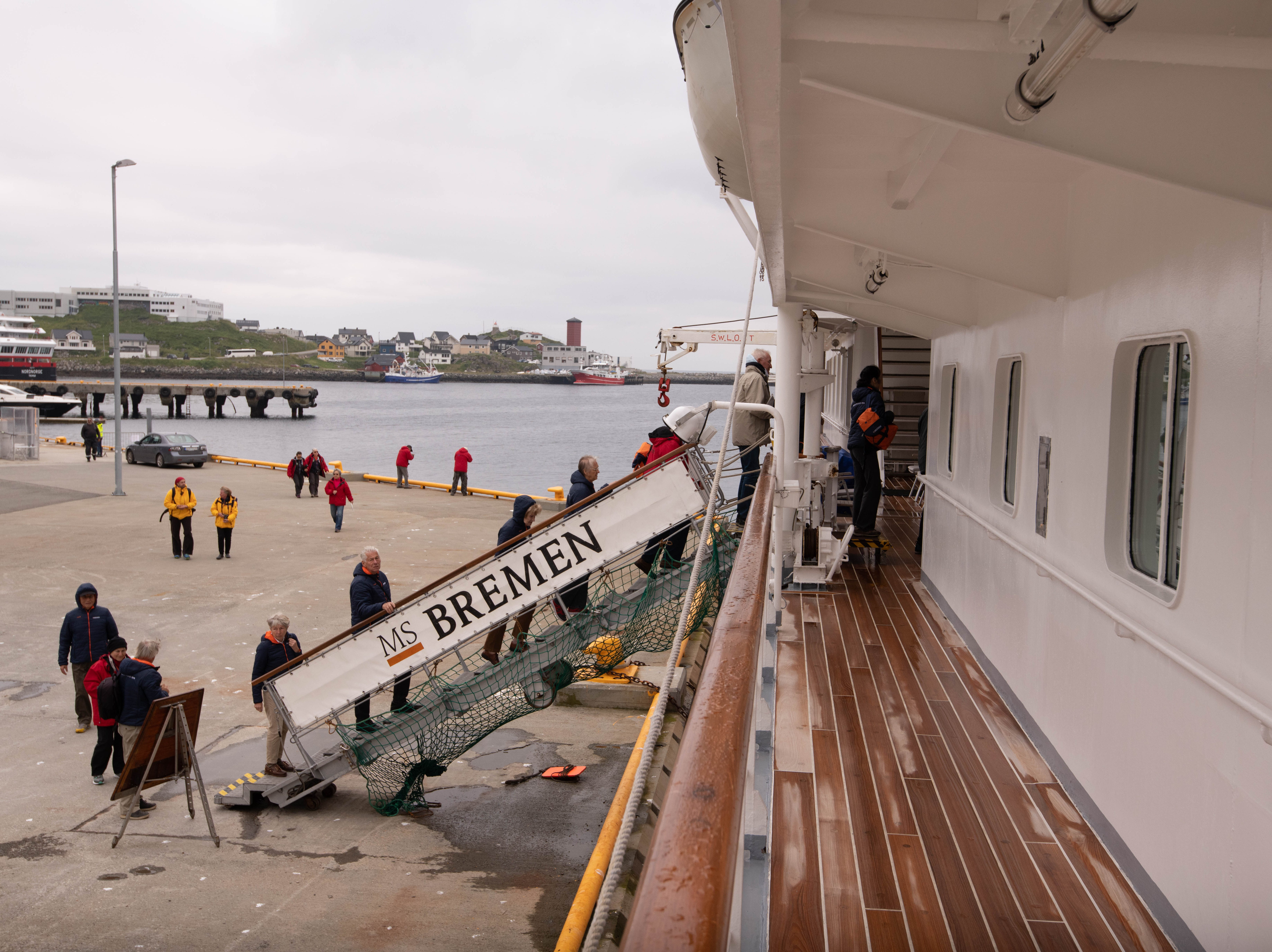 Passengers board Bremen via a ramp that travels with the ship. It's lowered into place by a crane at the top of the vessel that also is used to lower Zodiac boats used for landings.