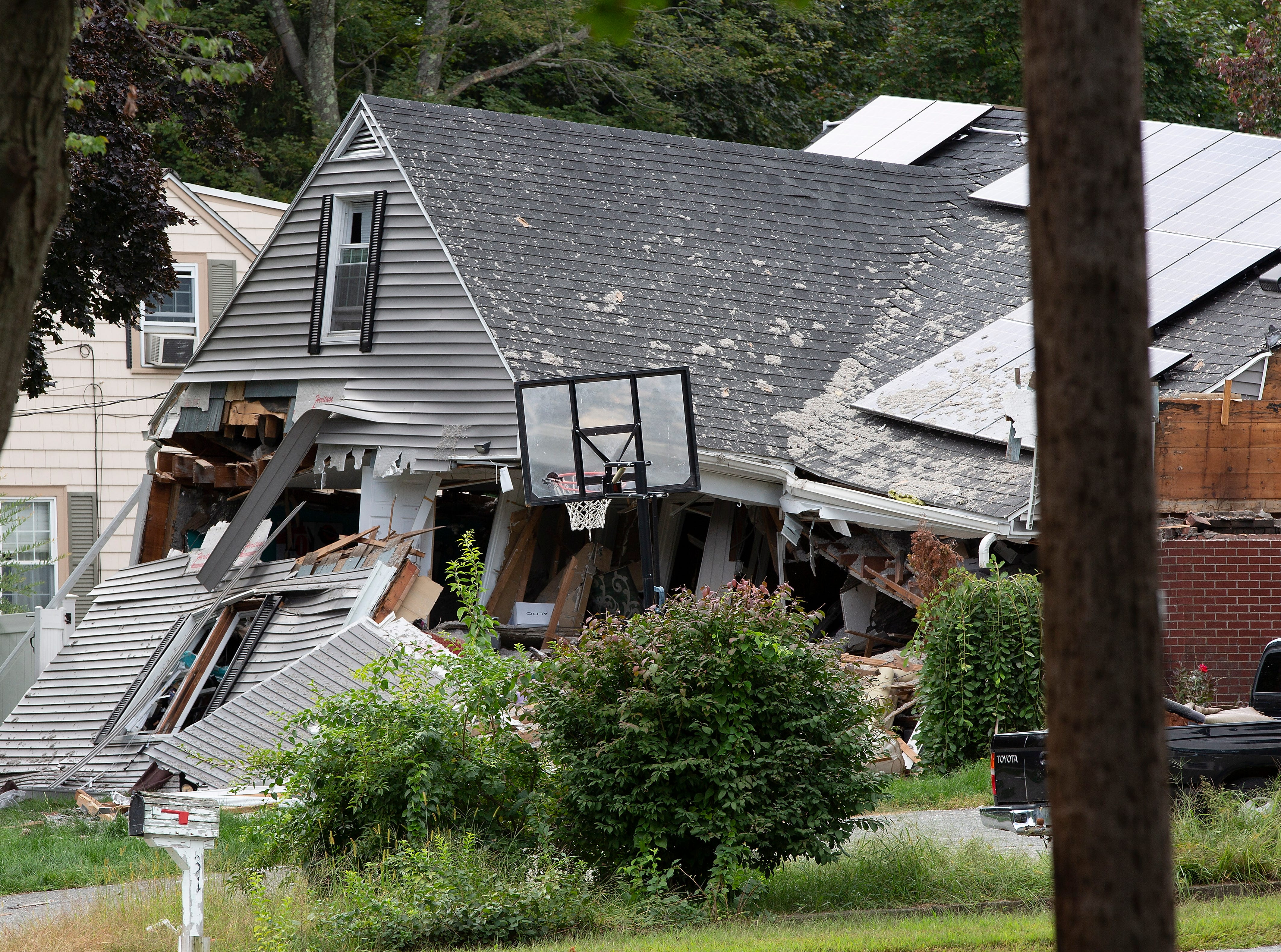 A destroyed home on Chickering Street where authorities say Leonel Rondon, 18, of Lawrence, Mass., was killed while seated in his car in the driveway, is seen, Friday. Dozens of houses in Lawrence, Andover and North Andover caught fire from the natural gas explosions.