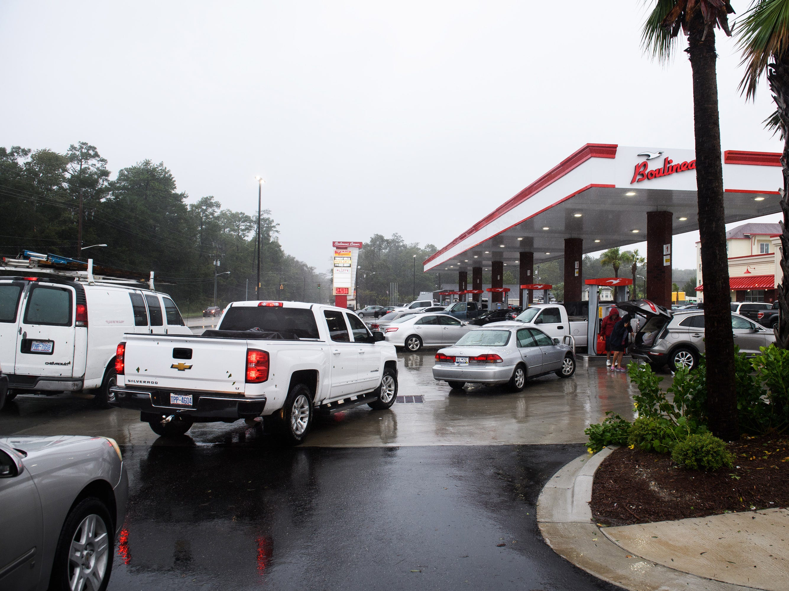 North Myrtle Beach, S.C. residents swarm Boulineau's Corner, one of the first gas stations to open since Hurricane Florence swept through the area, on Saturday, Sept. 15, 2018.