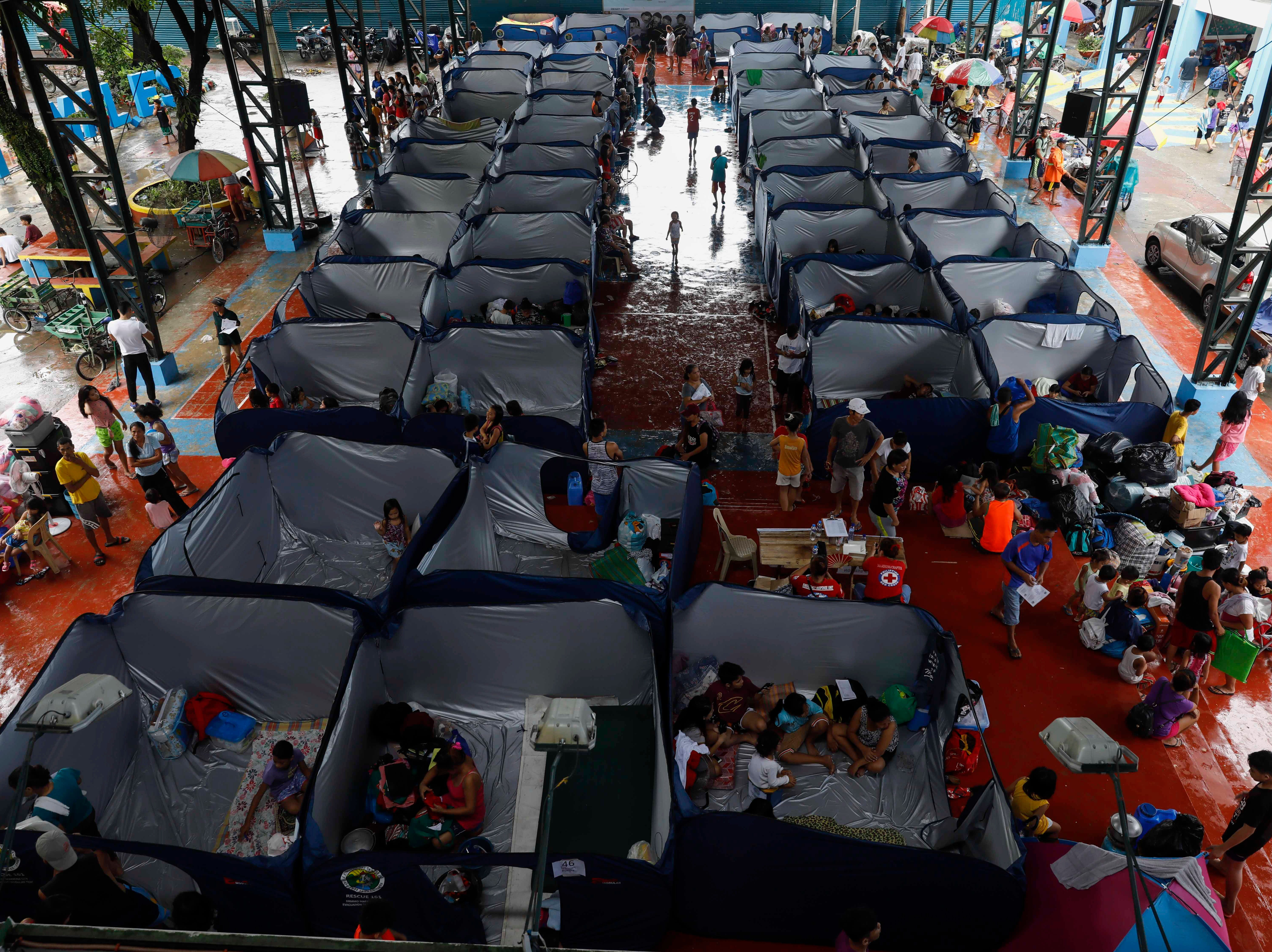 Residents who have been preventively evacuated due to typhoon use modular tents at an evacuation center in Marikina City, east of Manila, Philippines on Sept. 15, 2018.