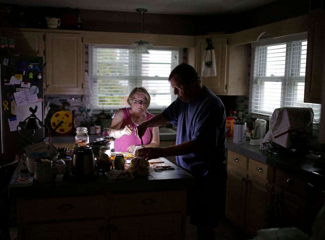 With use of a generator Ed and Nancy Schueren make dinner as they cope with no power and water after high winds and water from Hurricane Florence hit Swansboro, N.C., Friday.