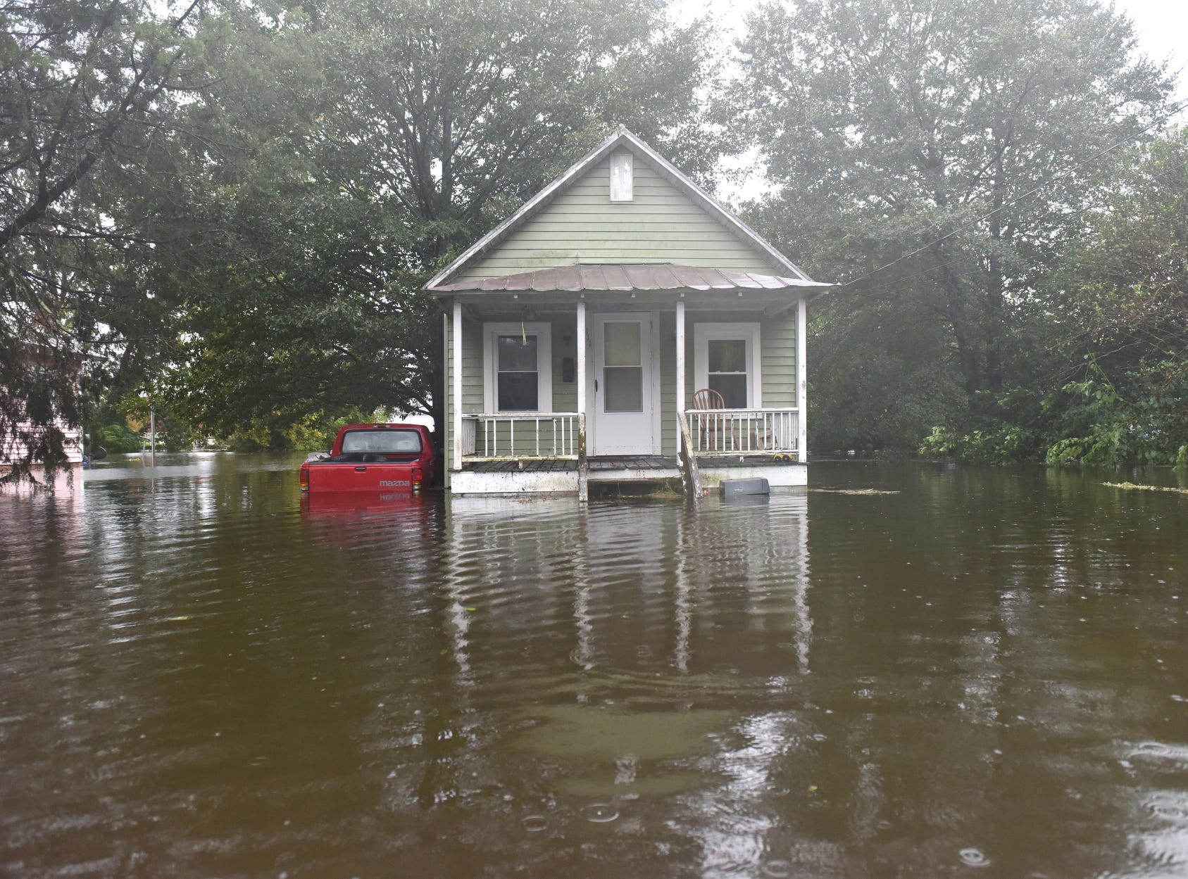 A home sits in high water on W 6th St after Hurricane Florence brought heavy rains to Washington, N.C. on Friday afternoon on Sept. 14, 2018.