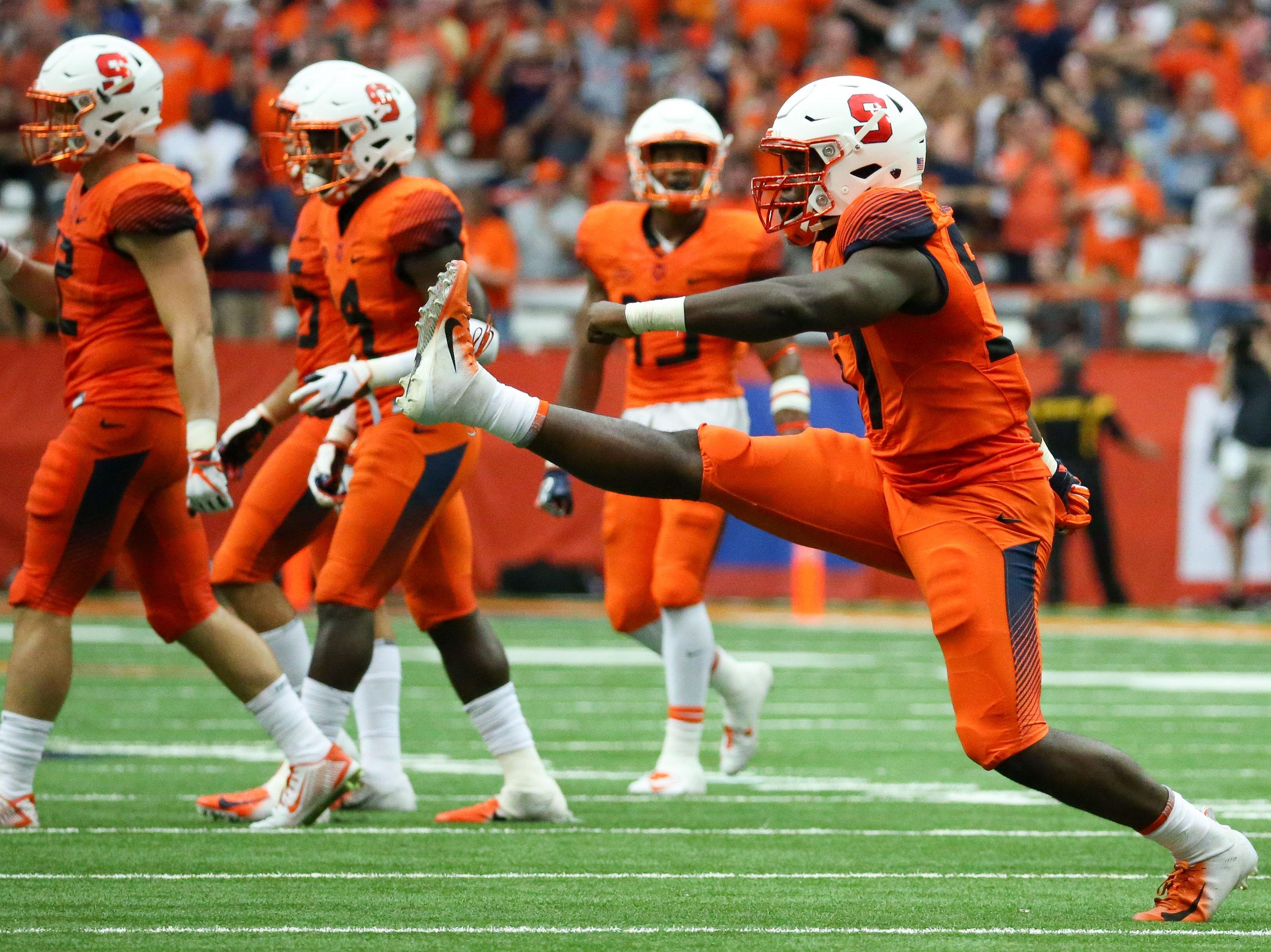 Syracuse Orange defensive lineman Kingsley Jonathan (57) celebrates his sack against the Florida State Seminoles during the third quarter at the Carrier Dome.