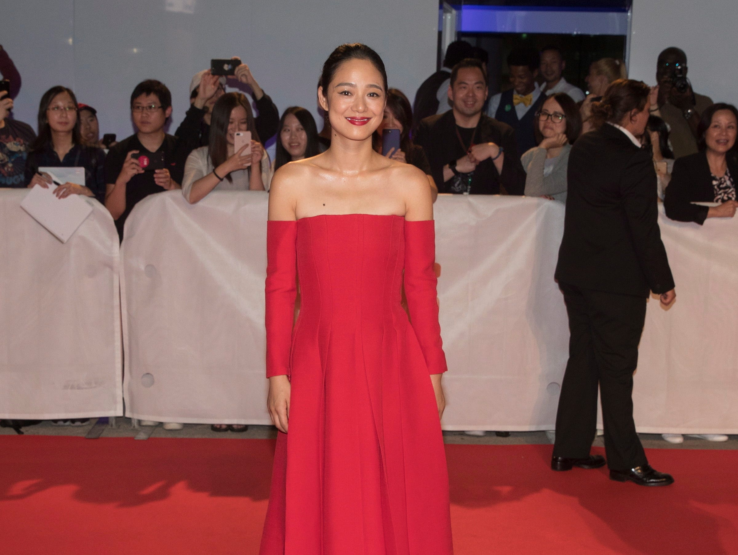 "Actress Qing Xu attends a red carpet for the movie ""Hidden Man"" during the 2018 Toronto International Film Festival in Toronto on Friday, Sept. 14, 2018. (Fred Thornhill/The Canadian Press via AP) ORG XMIT: FJT206"