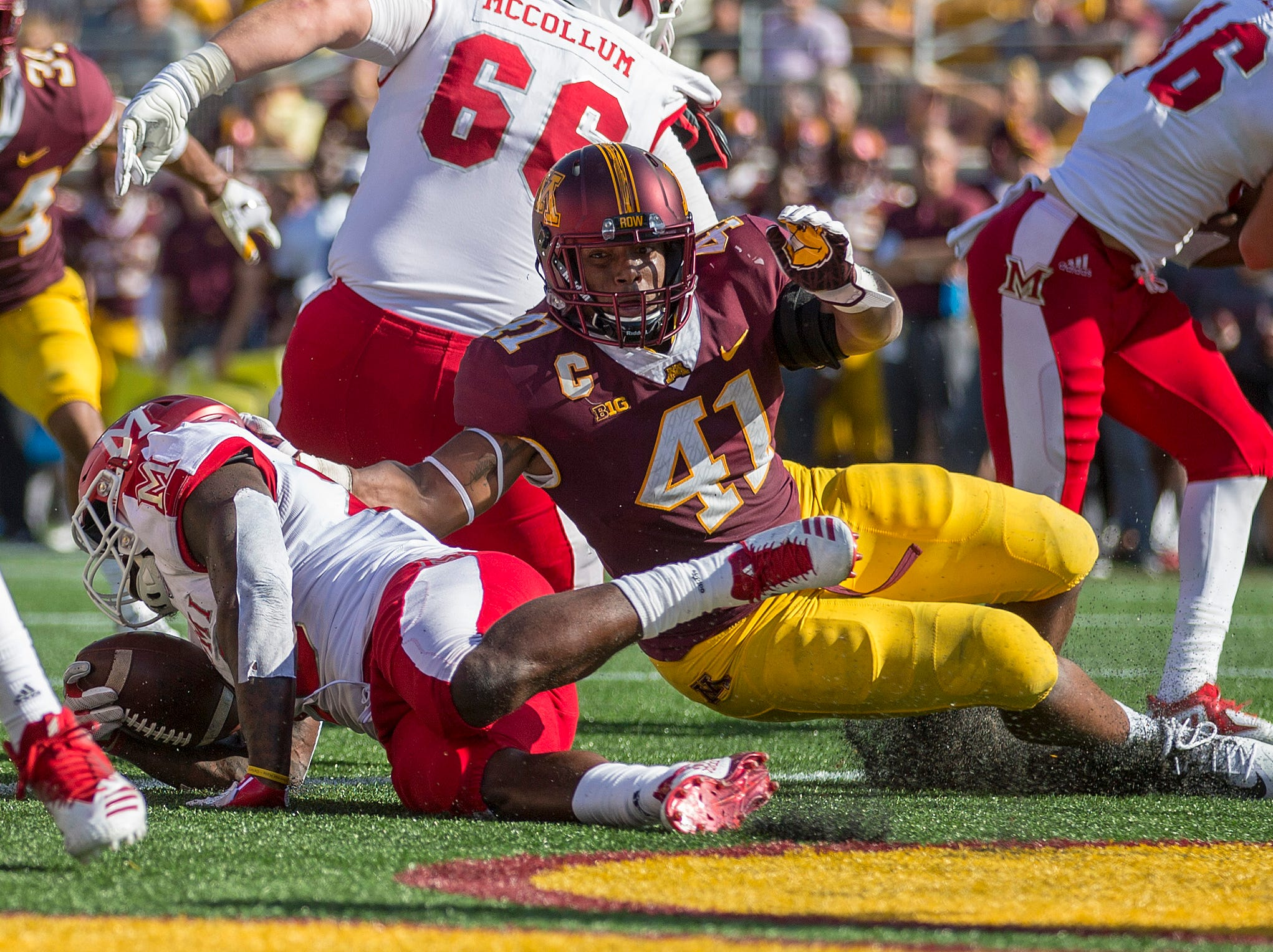 Minnesota Golden Gophers linebacker Thomas Barber (41) tackles Miami (Oh) Redhawks running back Davion Johnson (23) for a safety in the first half at TCF Bank Stadium.