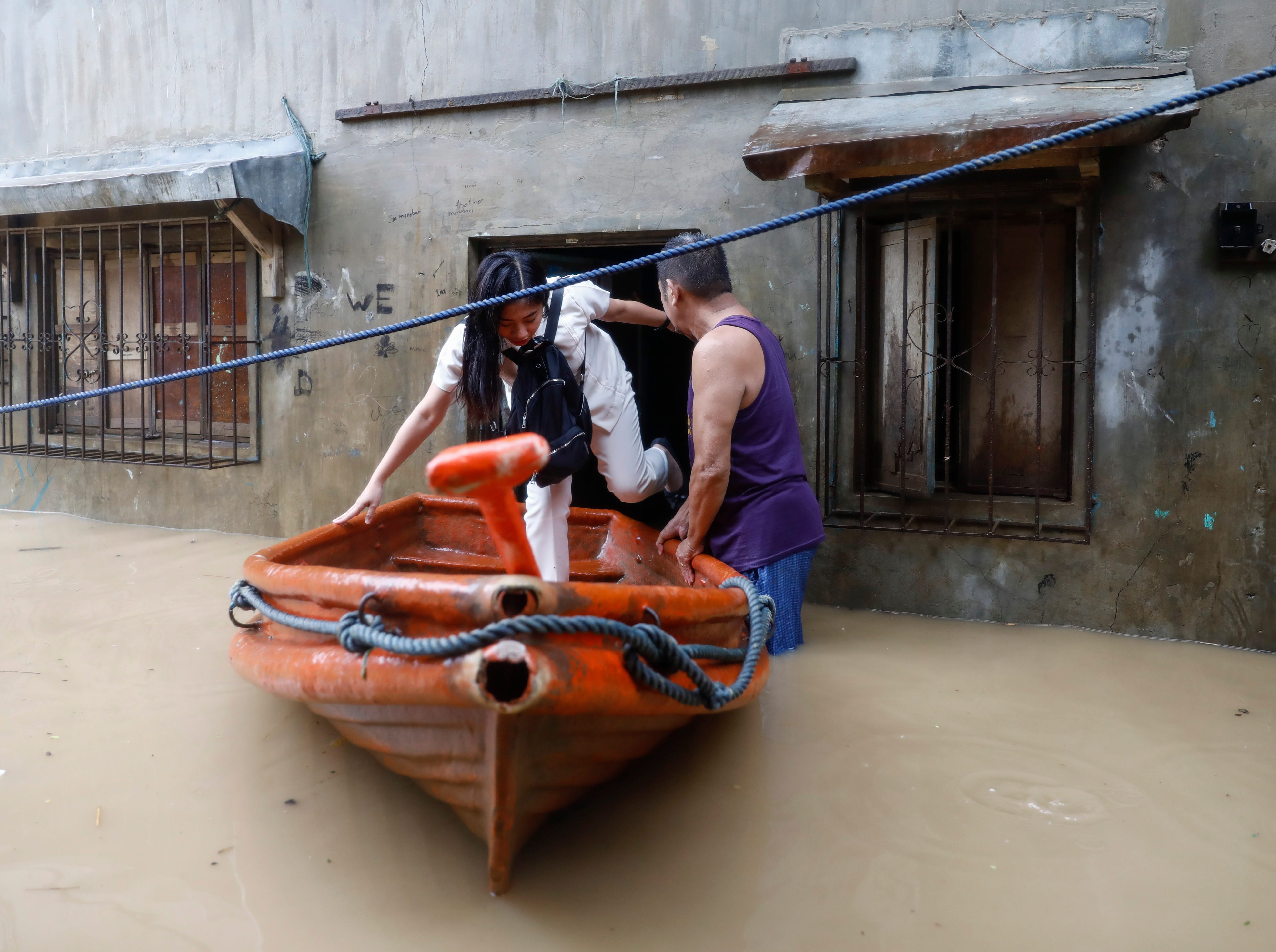 A resident tries to avoid floodwaters by boarding a raft in San Mateo town of Rizal Province, east of Manila, Philippines 15 September 2018. Mangkhut, the most powerful typhoon to strike the Philippines in the last five years, made landfall in the northeastern town of Baggao with maximum sustained winds of 128 mph and gusts of up to 177 mph.