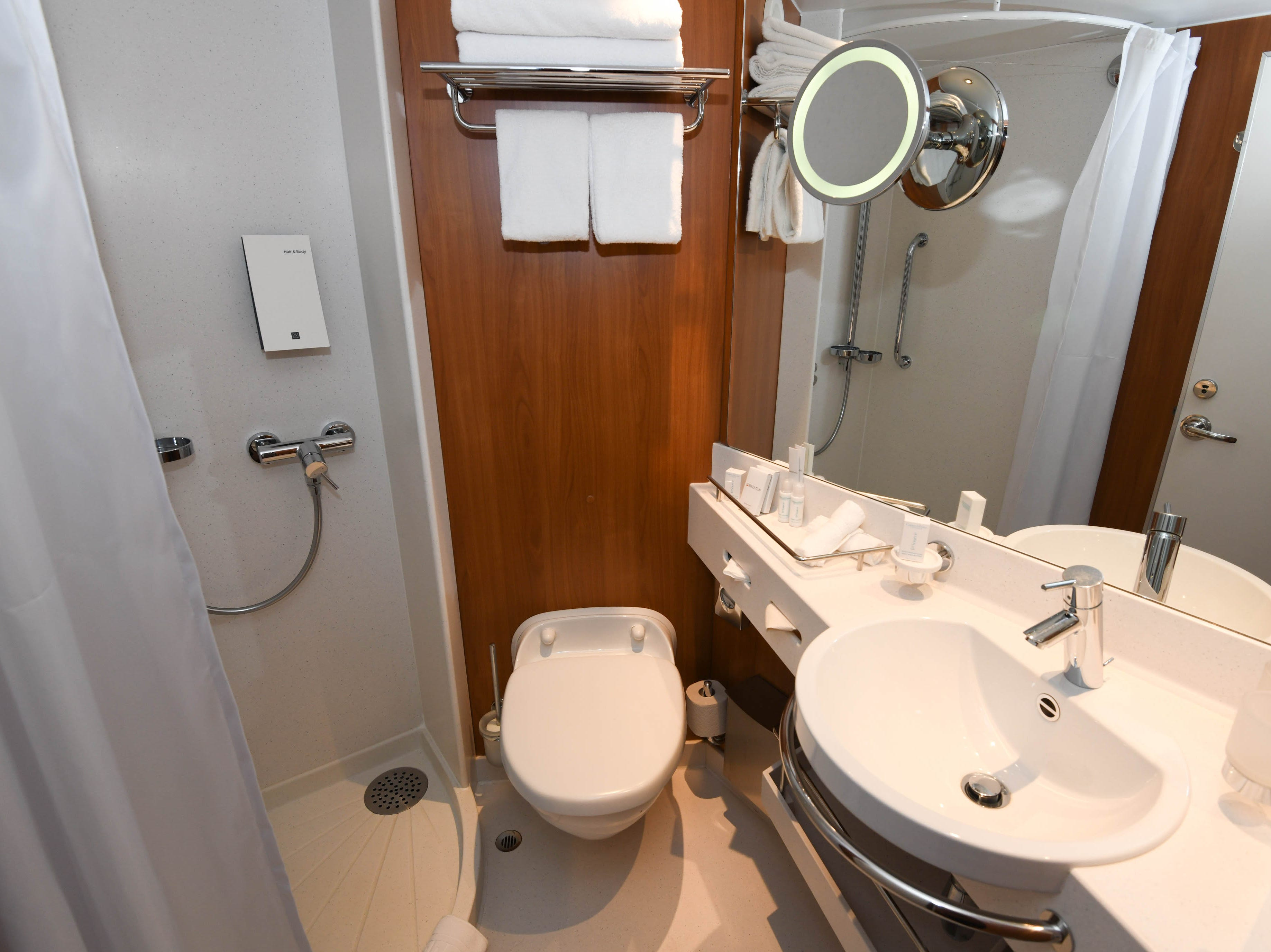 Cabins on Bremen have relatively small but well-designed bathrooms with a single sink, toilet and shower.