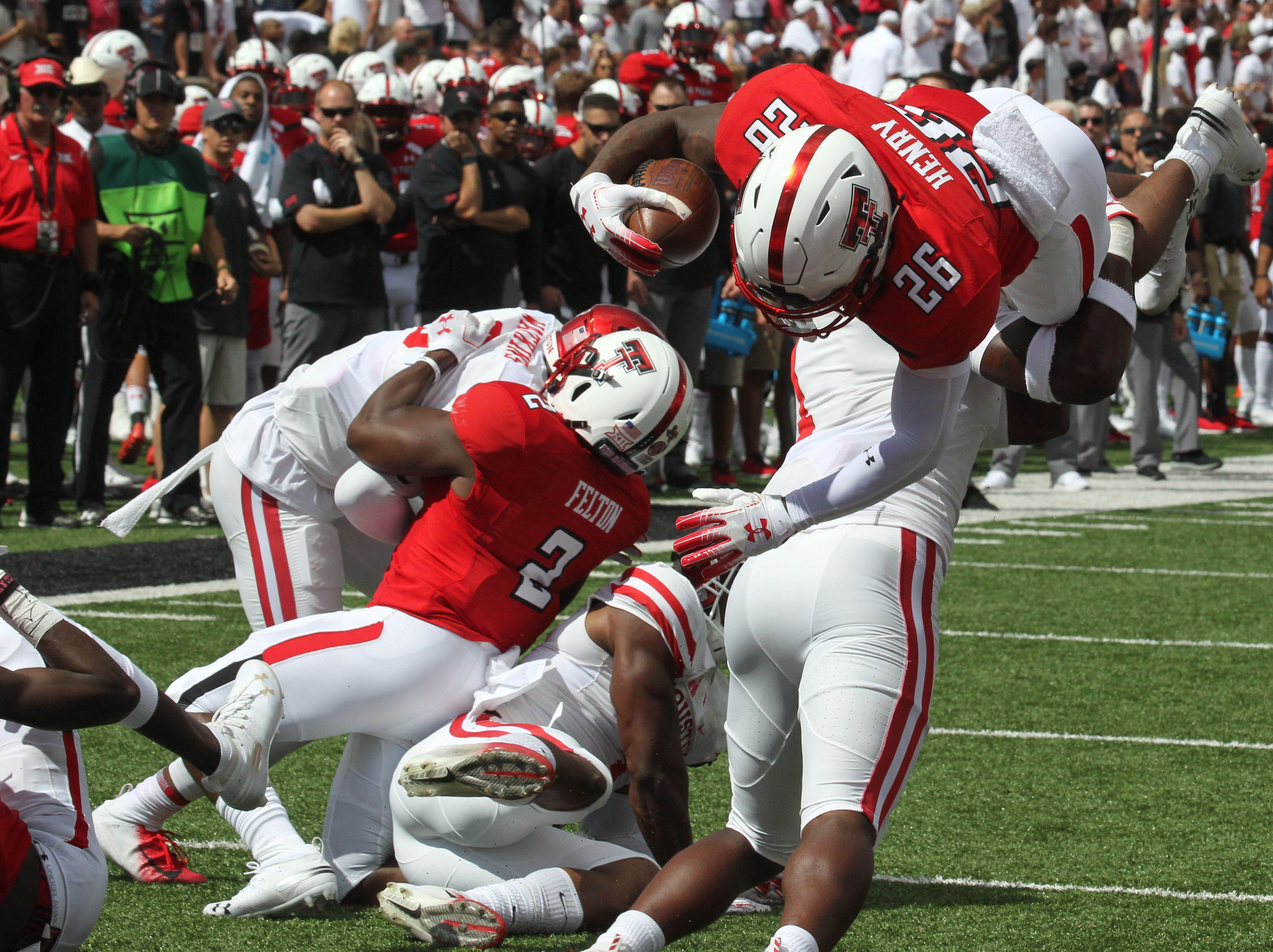 Texas Tech Red Raiders running back Ta'Zhawn Henry (26) dives for a touchdown against the Houston Cougars in the first half at Jones AT&T Stadium.