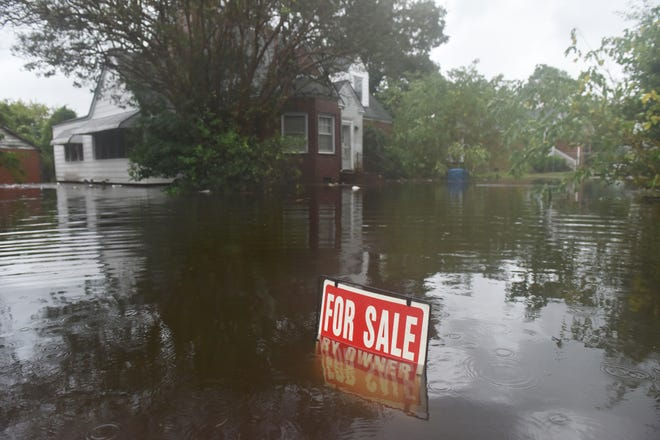 A home for sale sits in high water on W 6th St after Hurricane Florence brought heavy rains to Washington, N.C. on Friday afternoon on September 14, 2018.