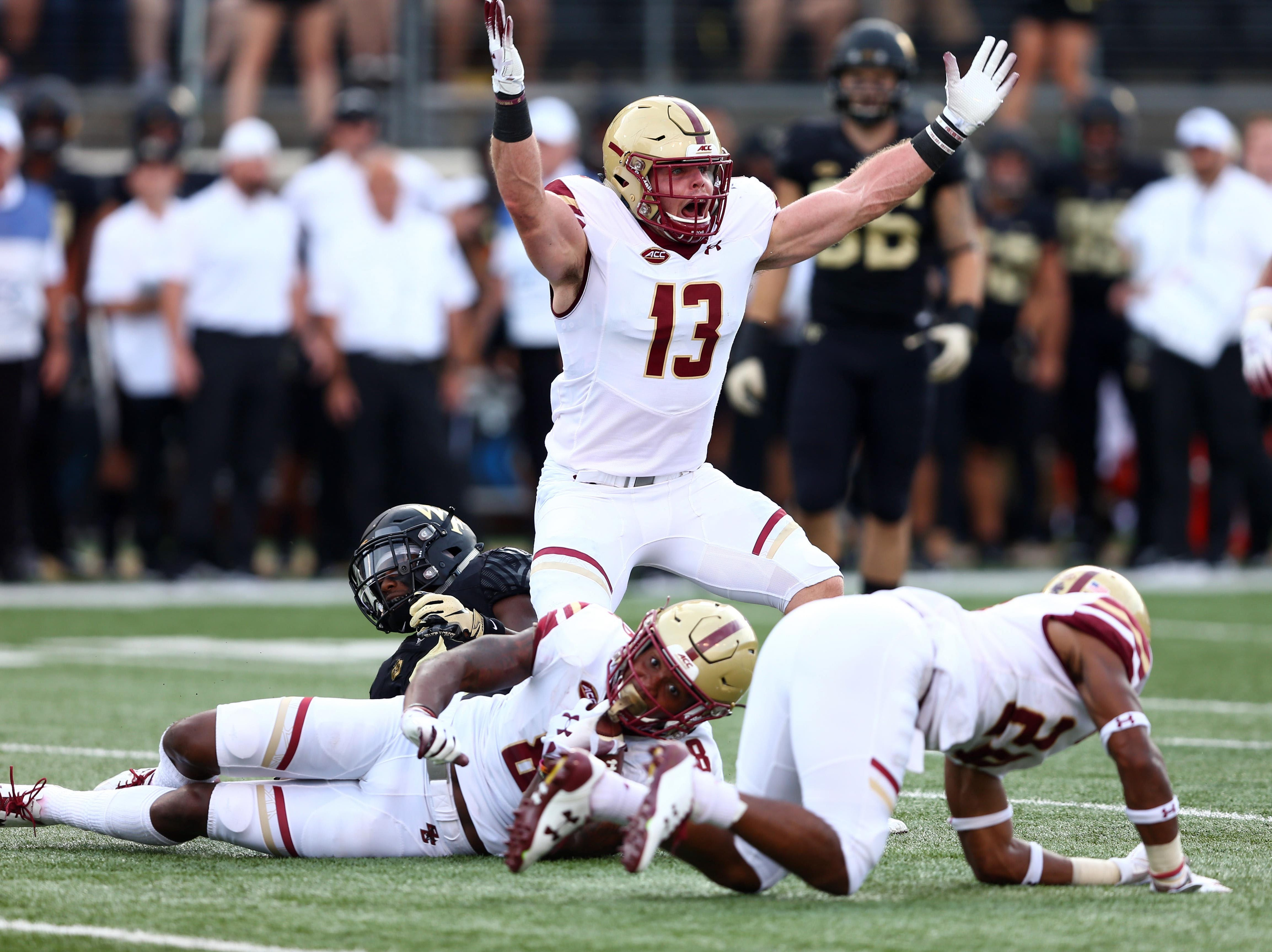 Boston College Eagles linebacker Connor Strachan (13) reacts to a turnover against the Wake Forest Demon Deacons in the first quarter  at BB&T Field.