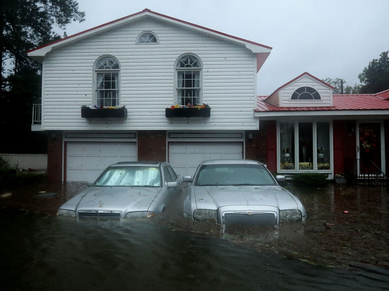 Homes are flooded after a storm surge from Hurricane Florence flooded the Neuse River on Sept.14, 2018 in New Bern, N.C.. Hurricane Florence made landfall in North Carolina as a Category 1. However, The storm has since been downgraded to a tropical storm.
