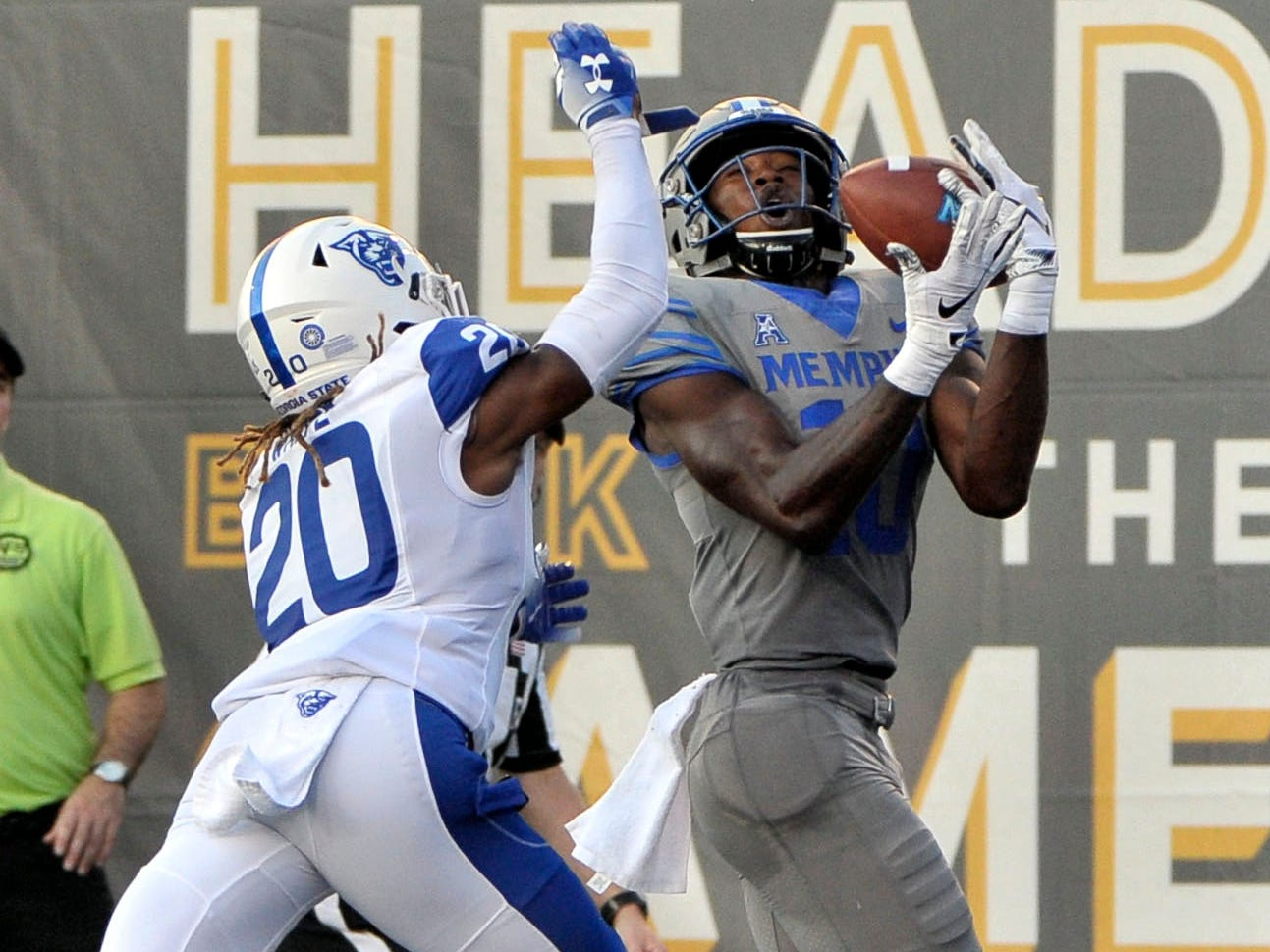 Memphis Tigers wide receiver Damonte Coxie (10) catches a touchdown pass against Georgia State Panthers cornerback Quavian White (20) during the first half at Liberty Bowl Memorial Stadium.