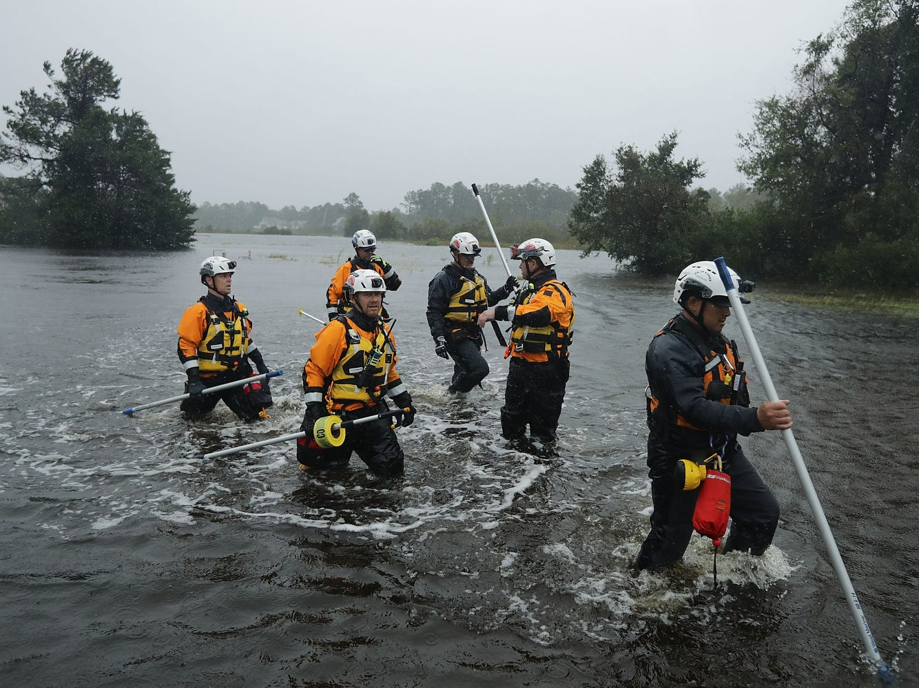 Members of the FEMA Urban Search and Rescue Task Force 4 from Oakland, California, search a flooded neighborhood for evacuees during Hurricane Florence, Friday, in Fairfield Harbour, N.C.,  Hurricane Florence made landfall in North Carolina as a Category 1 storm and flooding from the heavy rain is forcing hundreds of people to call for emergency rescues in the communities around New Bern, N.C., which sits at the confluence of the Neuse and Trent rivers.