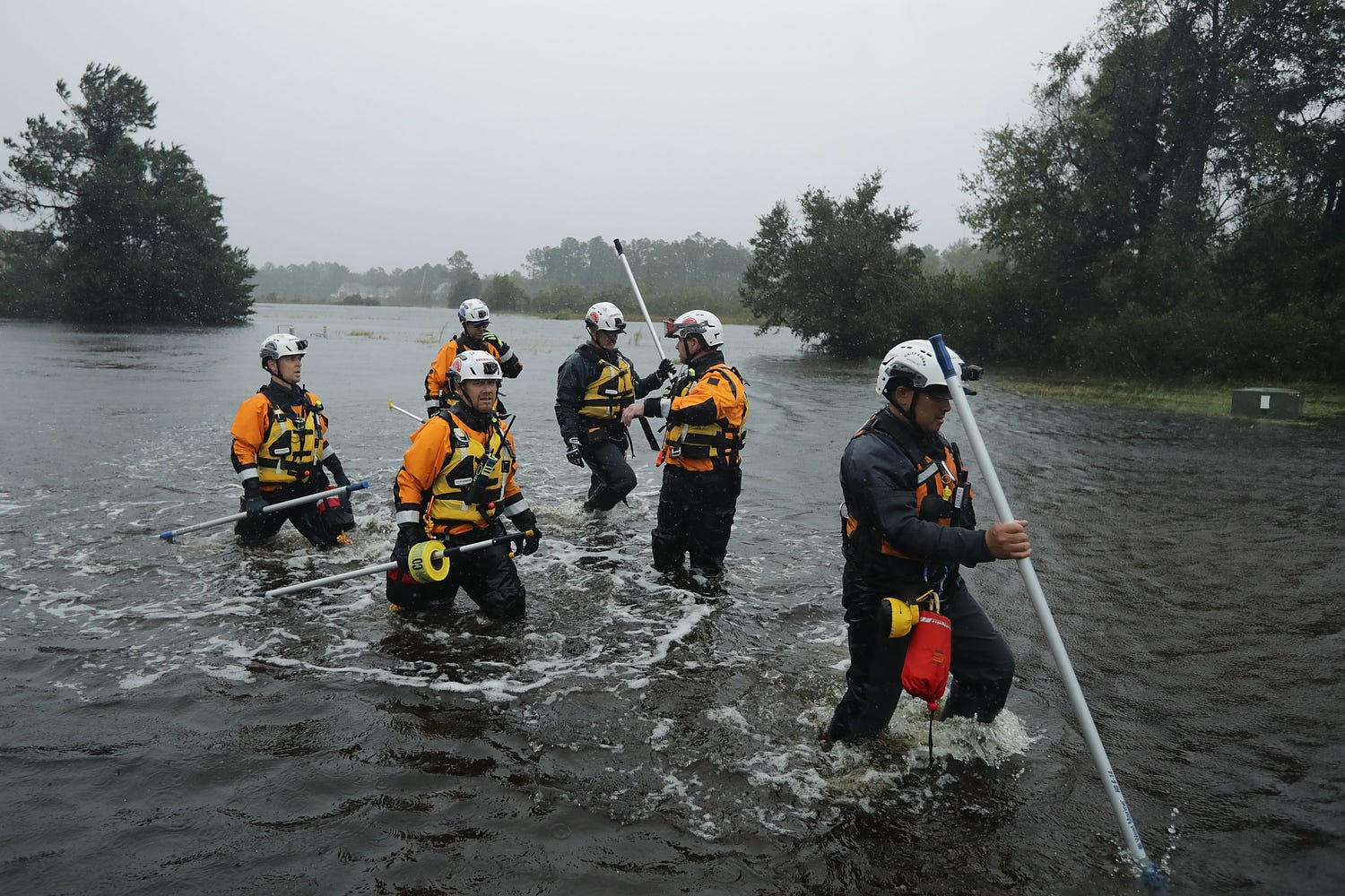 Members of the FEMA Urban Search and Rescue Task Force 4 from Oakland, California, search a flooded neighborhood for evacuees during Hurricane Florence, Friday, in Fairfield Harbour, N.C.