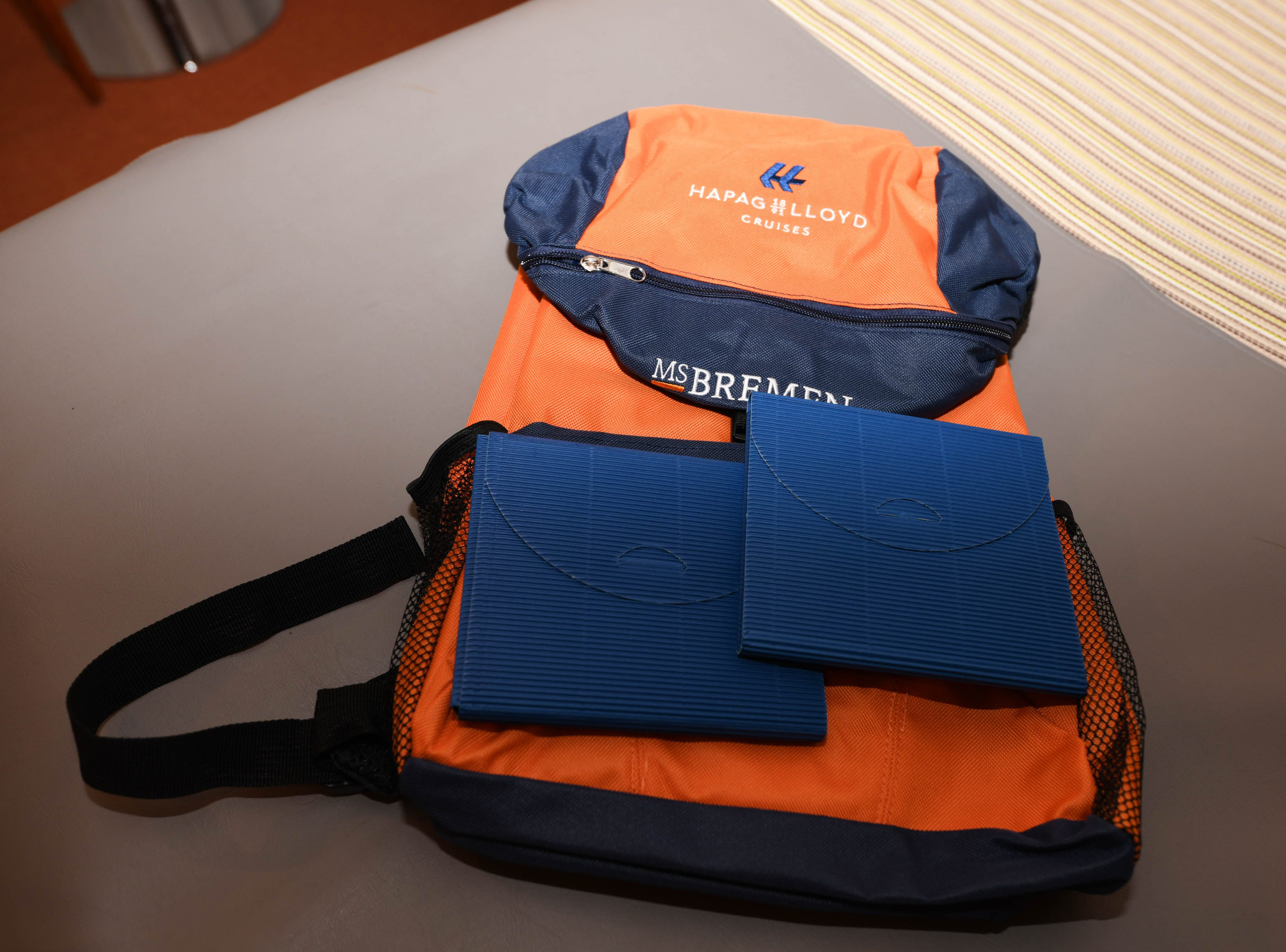 Passengers on Bremen expedition cruises receive a Hapag-Lloyd Cruises backpack upon arrival to use during Zodiac landings.