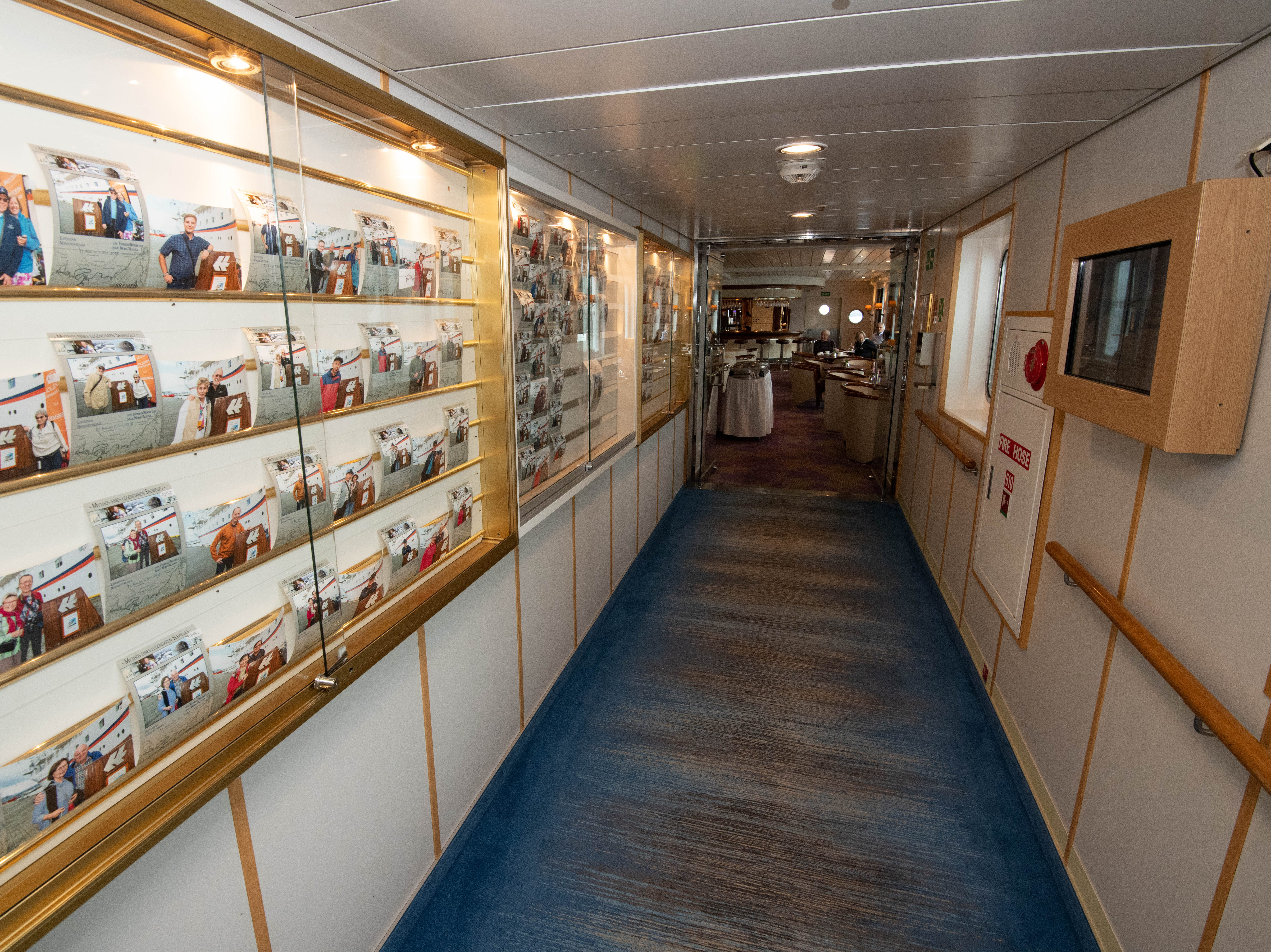 Just outside of the main dining room is a photo wall with for-purchase photos by the ship's photographer.