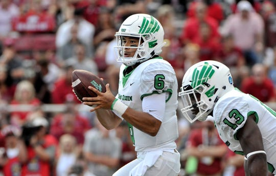 North Texas quarterback Mason Fine (6) handles the ball during an upset of Arkansas this season. The Mean Green will play Utah State in the New Mexico Bowl.