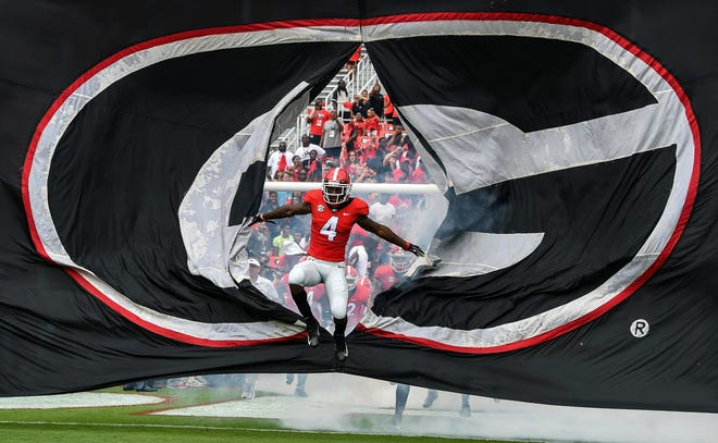 Georgia Bulldogs player Mecole Hardman (4) leads his team during pregame activities prior to the game  against the Middle Tennessee Blue Raiders at Sanford Stadium.