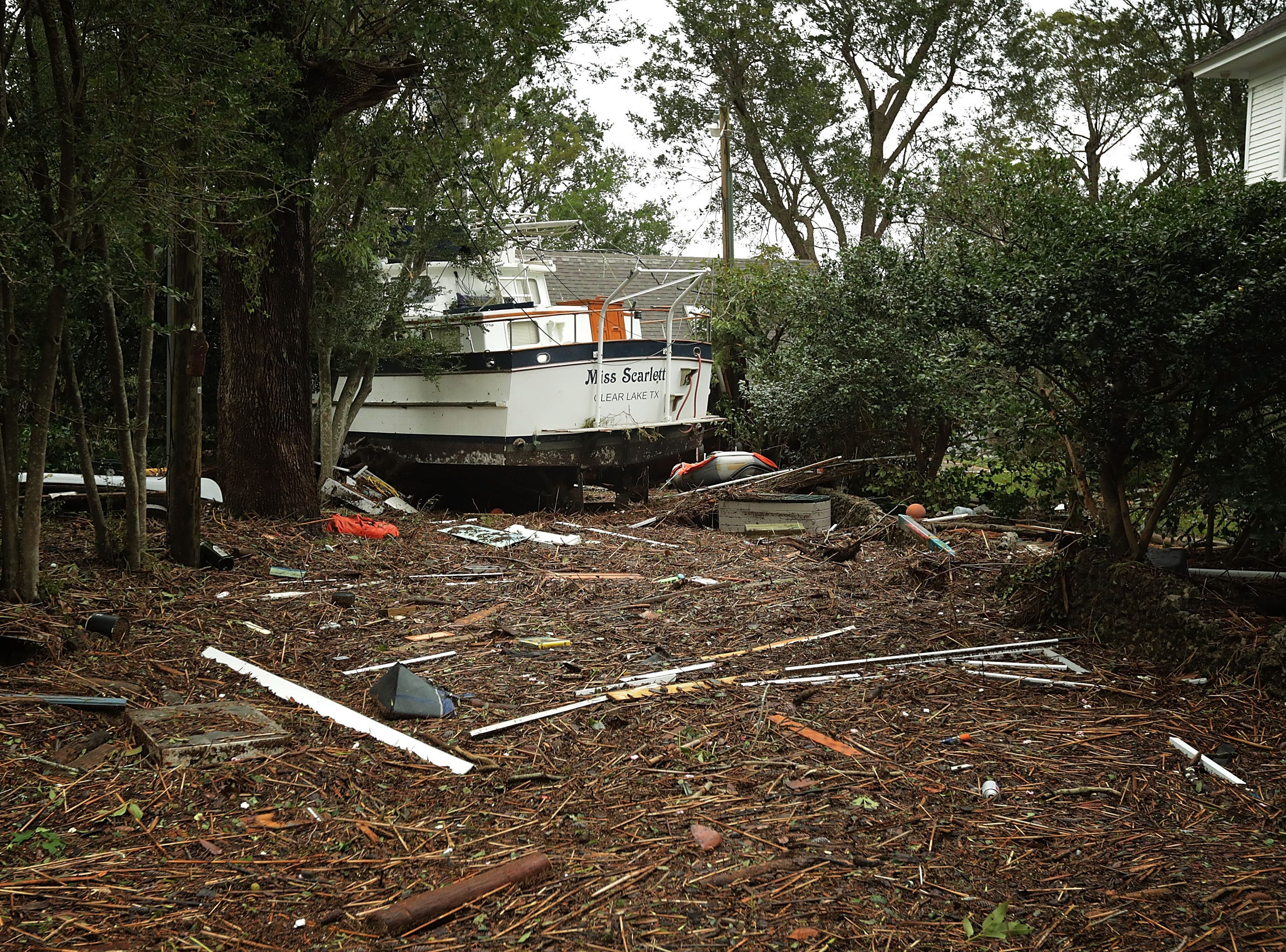 A boat sits at the end of a driveway after a four-foot storm surge produced by Hurricane Florence ripped through the this historic neighborhood along the Nuese River Sept. 15, 2018 in New Bern, N.C.. Hurricane Florence made landfall in North Carolina as a Category 1 storm Friday and at least five deaths have been attributed to the storm, which continues to produce heavy rain and strong winds extending out nearly 200 miles.