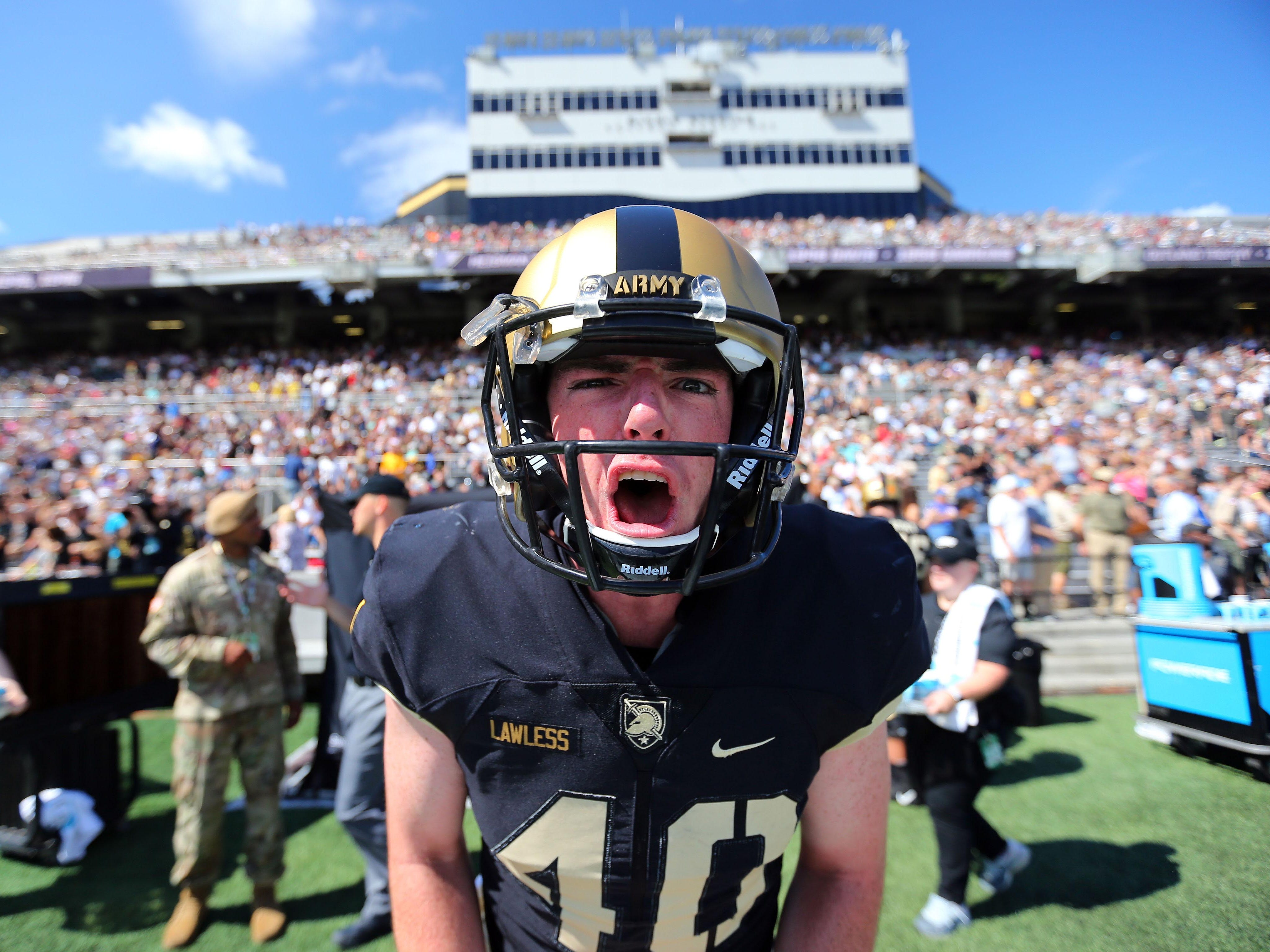 Army long snapper Paul Lawless (40) lets out a roar before the Black Knights faced Hawaii at Michie Stadium.
