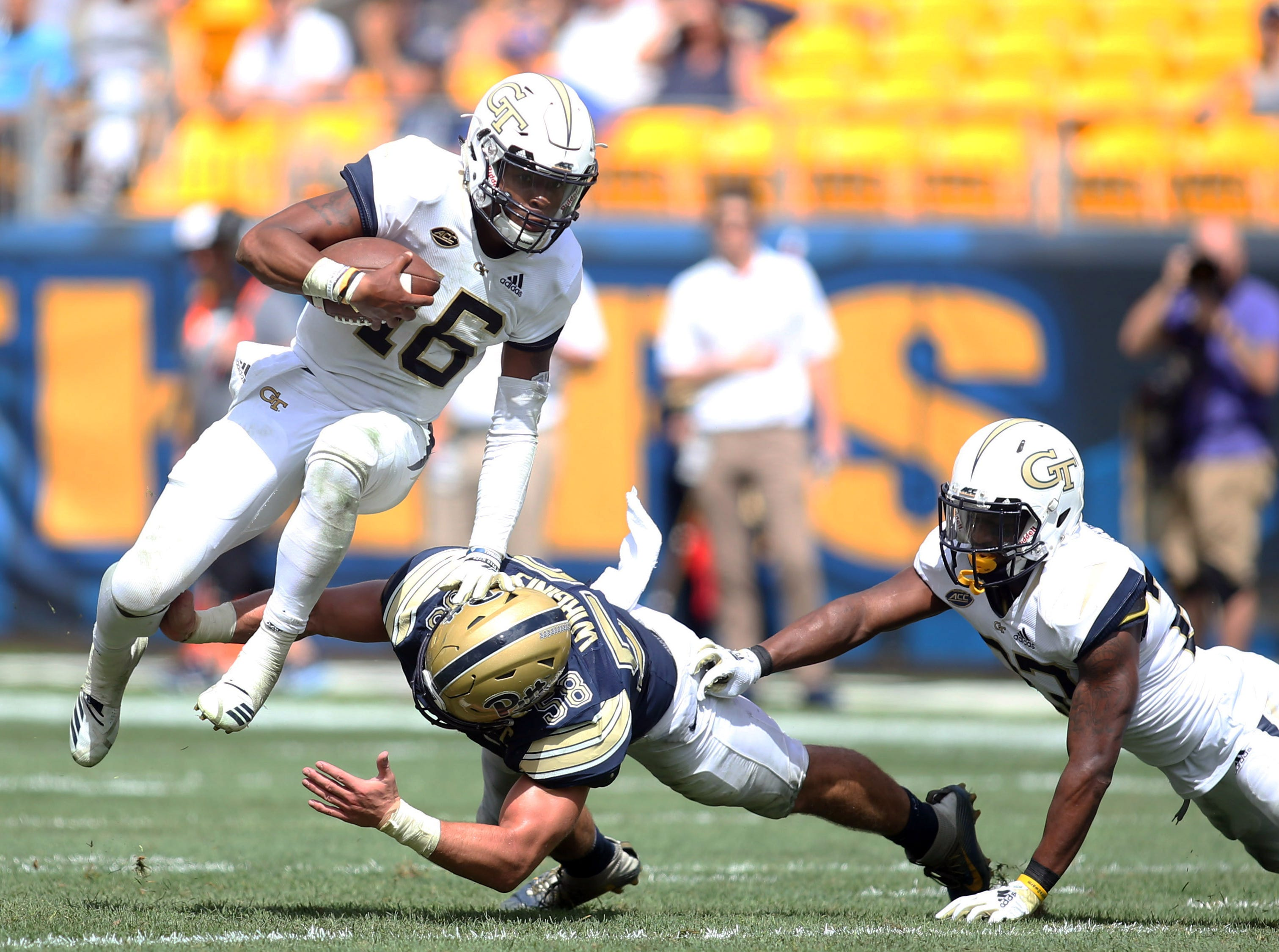 Georgia Tech Yellow Jackets quarterback TaQuon Marshall (16) runs the ball against Pittsburgh Panthers linebacker Quintin Wirginis (58) during the second quarter at Heinz Field.