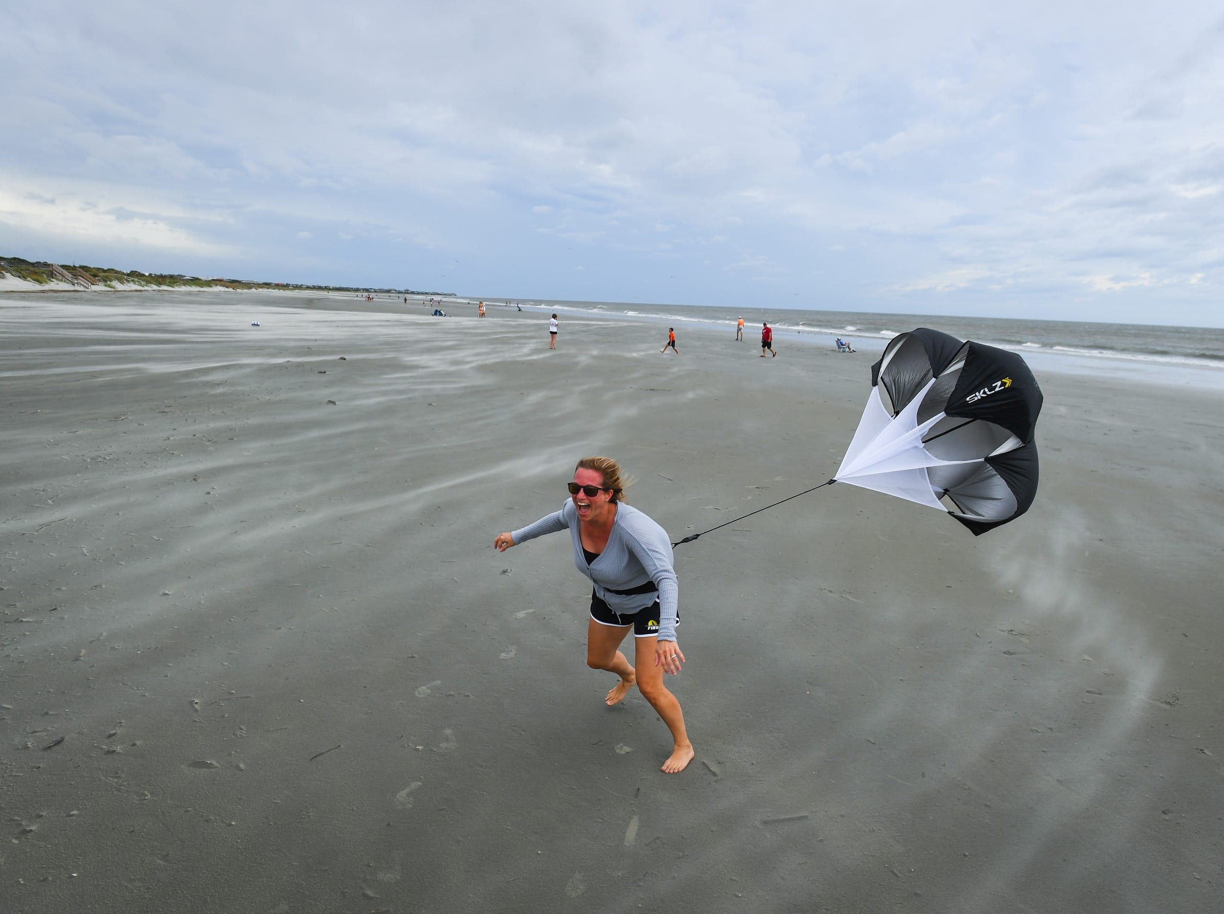 Stephanie Lemke of Mt. Pleasant, SC, enjoys the increase in the winds on Isle of Palms Beach on Friday afternoon prior to the arrival of winds and rain from Hurricane Florence.