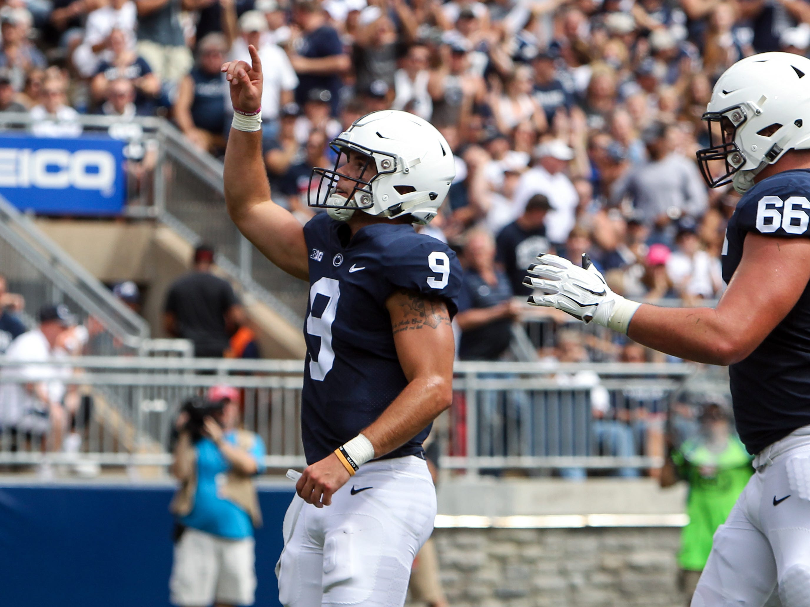 Penn State Nittany Lions quarterback Trace McSorley (9) scores a touchdown during the first quarter against the Kent State Golden Flashes at Beaver Stadium.