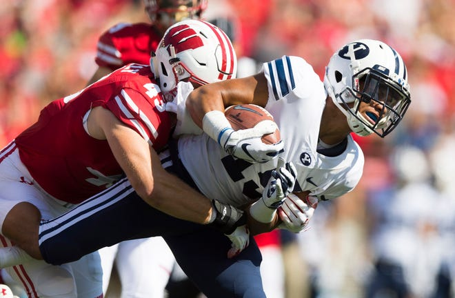 BYU Cougars wide receiver Aleva Hifo (15) is tackled by Wisconsin Badgers linebacker Ryan Connelly (43) during the first quarter at Camp Randall Stadium.