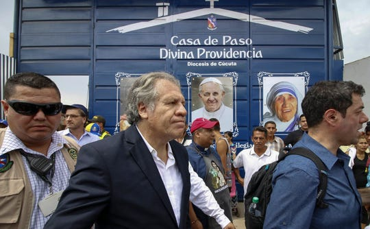 """The Secretary-General of the Organization of American States (OAS), Uruguayan Luis Almagro (C), greets Venezuelans during his visit to the Divina Providencia migrant shelter in Cucuta, Colombia, on the border with Venezuela, on September 14, 2018. - Almagro is in Cucuta as part of a three-day visit to Colombia to discuss the Venezuelan migratory crisis which has been described as """"the largest migration crisis"""" of the Western Hemisphere. According to the United Nations, about 2.3 million people left the oil-producing country since 2014, plunged into an acute economic crisis. (Photo by SCHNEYDER MENDOZA / AFP)SCHNEYDER MENDOZA/AFP/Getty Images ORIG FILE ID: AFP_19421G"""