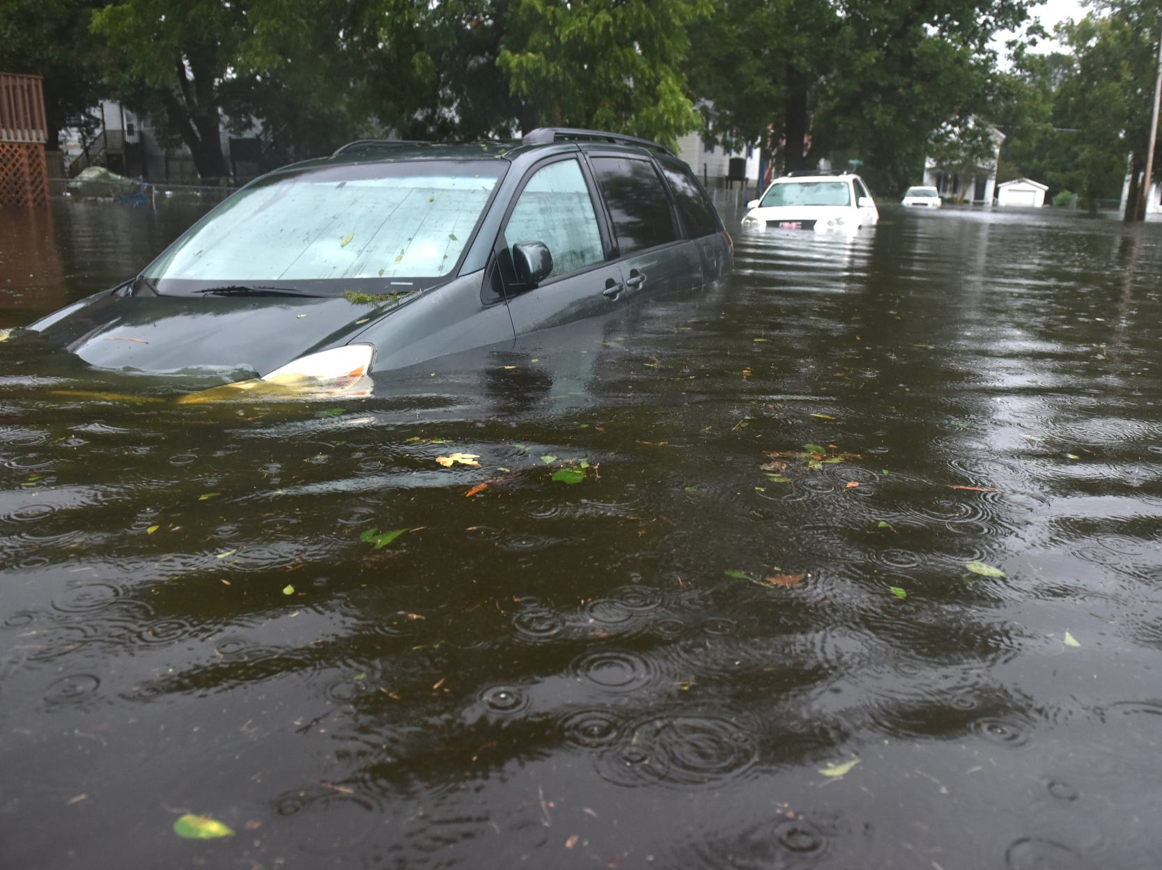Cars sit in high water on W 6th St after Hurricane Florence brought heavy rains to Washington, N.C. on Friday.
