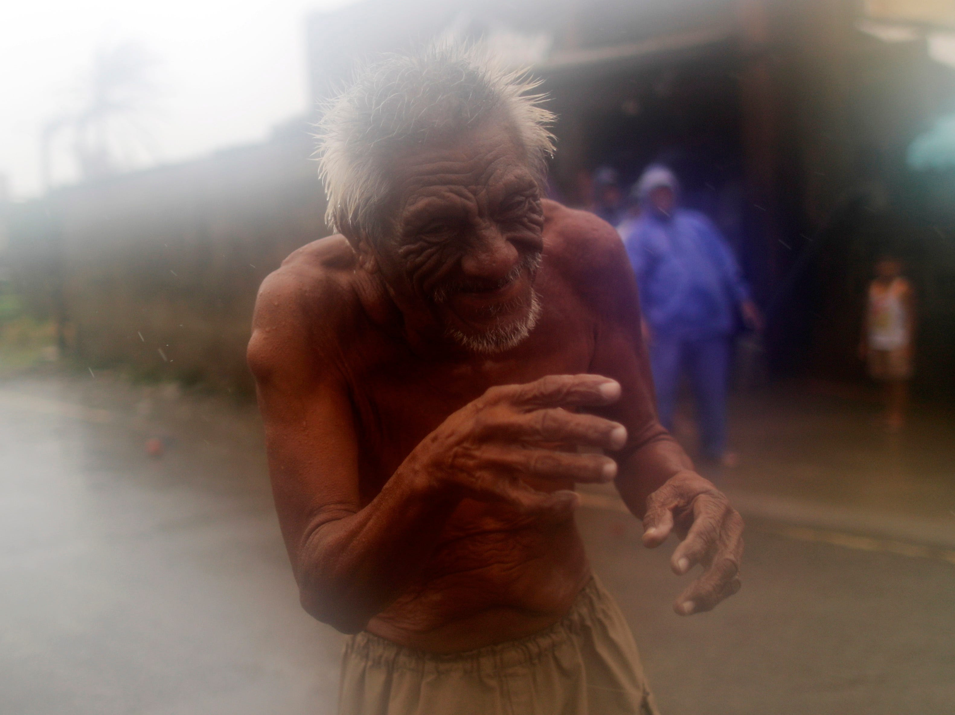 A Filipino elderly man is seen in the typhoon-hit town of Aparri, Cagayan province, Philippines on Sept. 15, 2018.