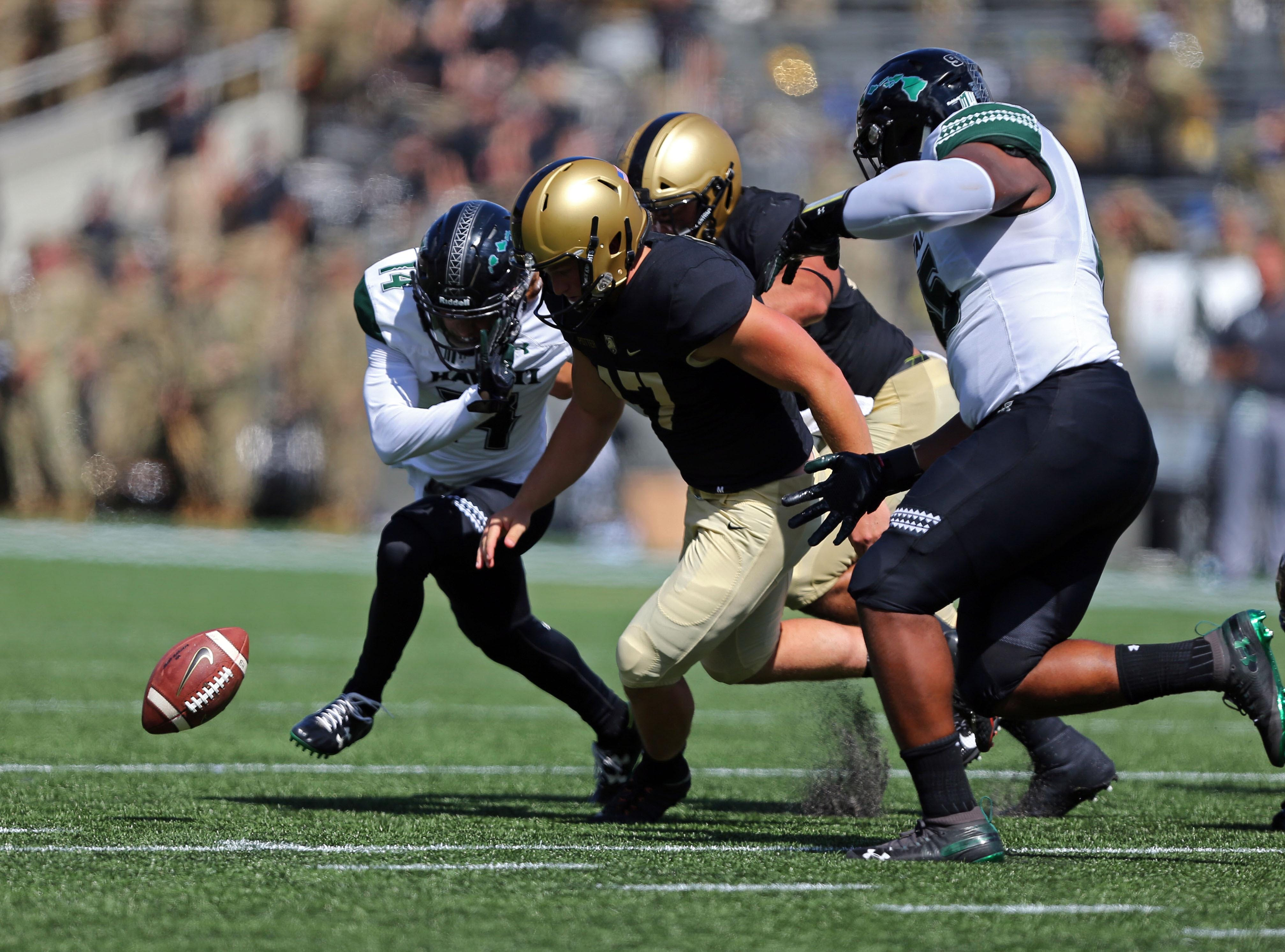 Army Black Knights punter Zach Potter (17) chases after the ball after Hawaii Rainbow Warriors defensive back Manu Hudson-Rasmussen (14) blocked a field goal during the first half at Michie Stadium.