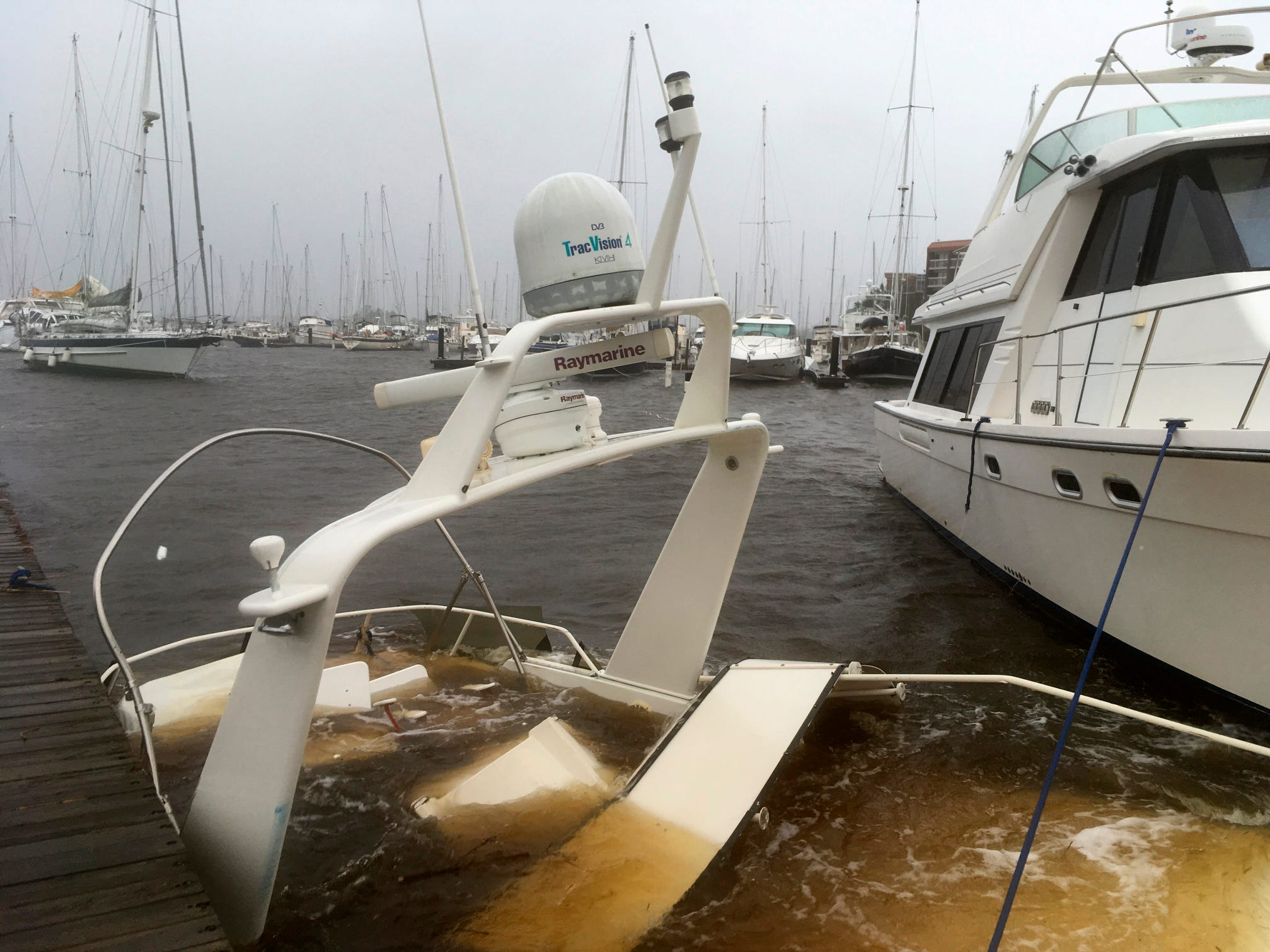 The mast of a sunken boat sits at a dock at the Grand View Marina in New Bern, N.C., on Friday.  Winds and rains from Hurricane Florence caused the Neuse River to swell, swamping the coastal city.