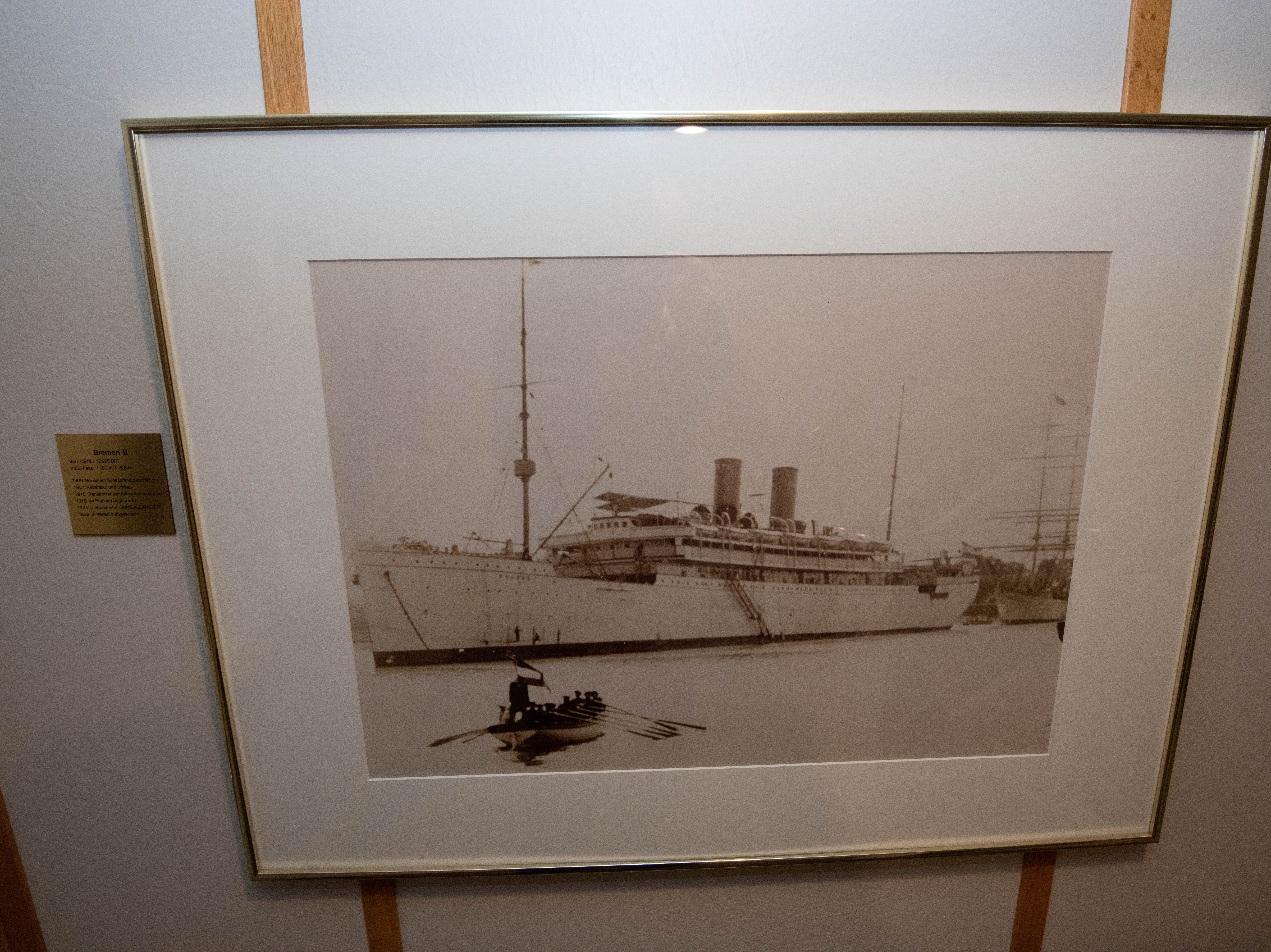 A photograph hanging in the main stairwell of Bremen shows the second ship to carry the name. Built for Norddeutscher Lloyd, this earlier Bremen was a trans-Atlantic ocean liner that sailed between Bremen, Germany and New York and also to Australia. The vessel  was laid up during World War I and later given to British line P&O line as part of war reparations.