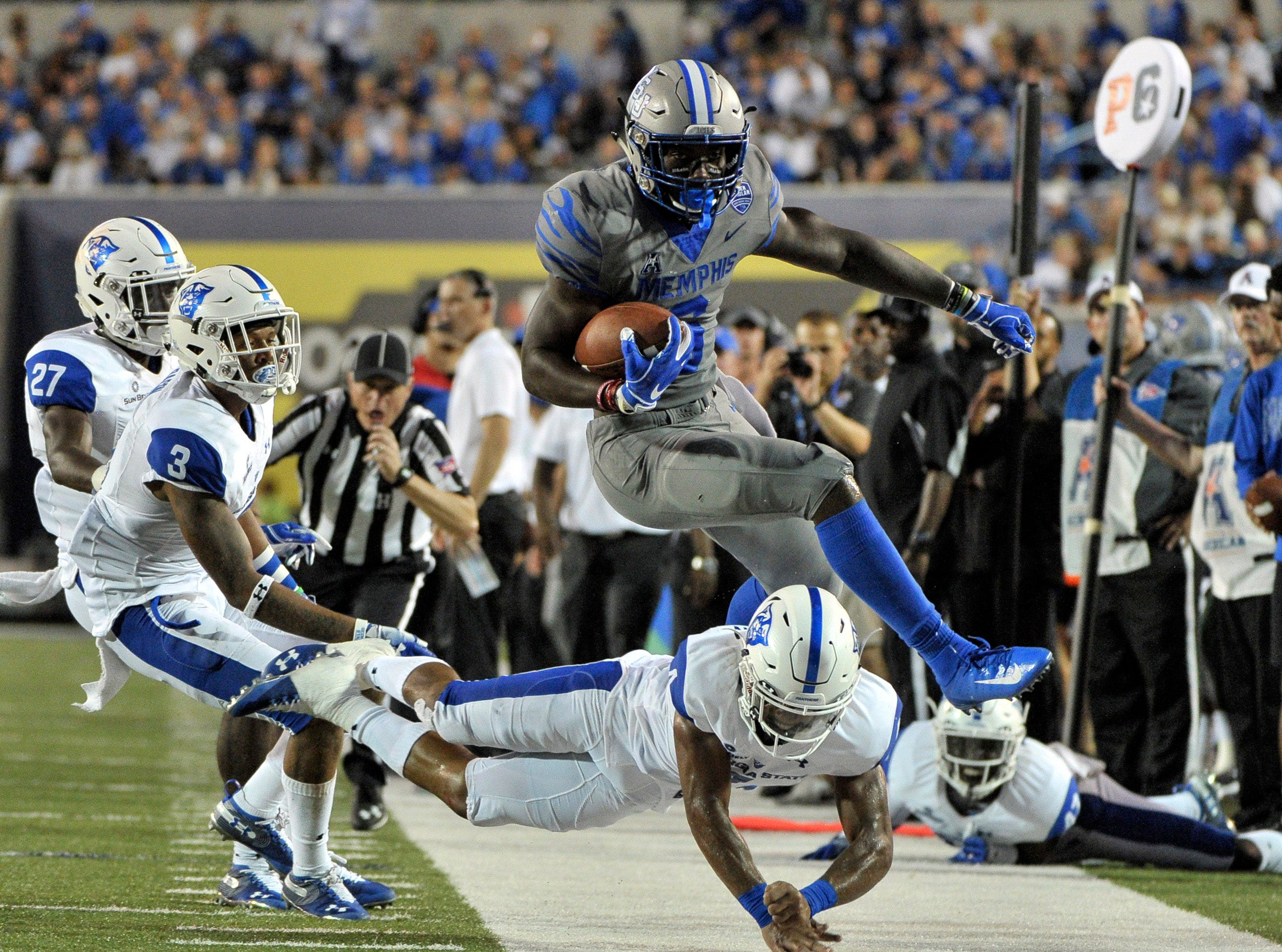 Memphis Tigers running back Patrick Taylor Jr. (6) is tackled by Georgia State Panthers cornerback Khai Anderson (4) during the first half at Liberty Bowl Memorial Stadium.