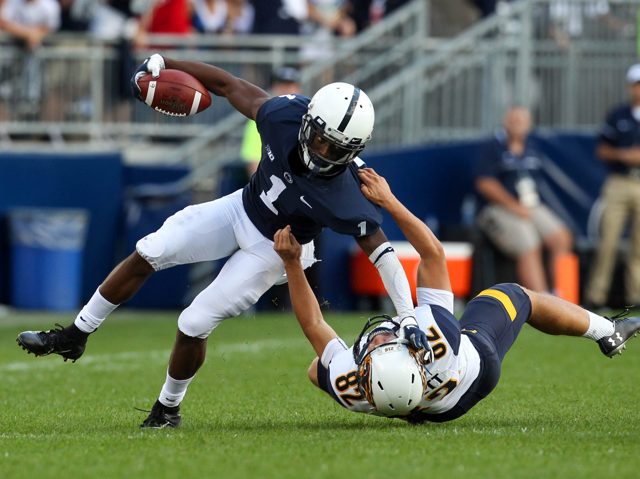 Penn State Nittany Lions wide receiver KJ Hamler (1) runs with the ball as Kent State Golden Flashes kicker Matthew Trickett (82) attempts a tackle during the third quarter at Beaver Stadium.