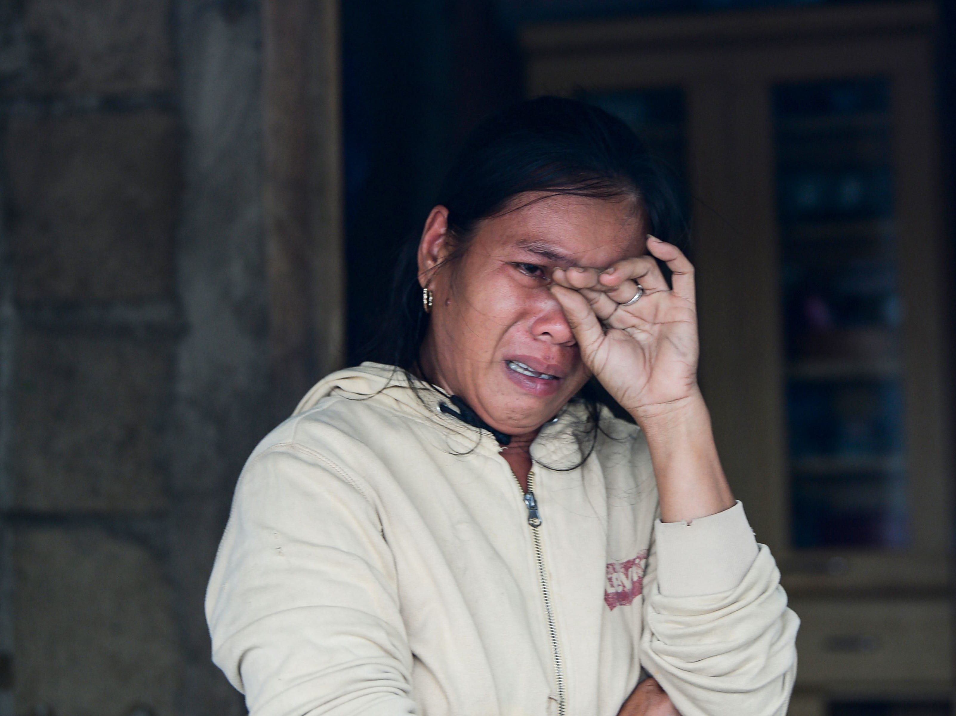 A woman weeps as she talks about her family's experience at the height of Super Typhoon Mangkhut in the town of Baggao, Cagayan province on Sept. 15, 2018.
