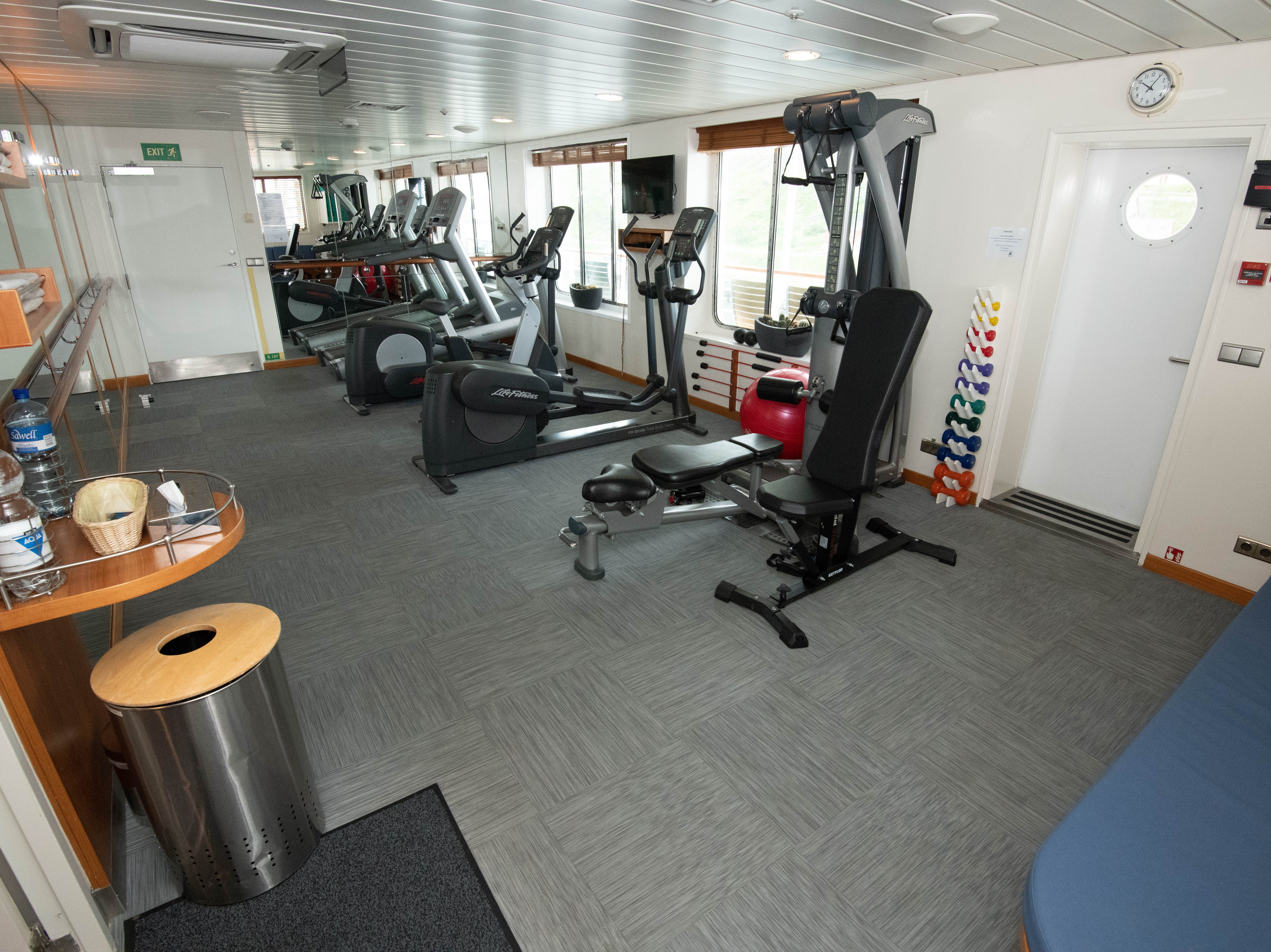 The fitness center has a single weight machine that offers a range of exercise options. There also are a small number of hand weights.