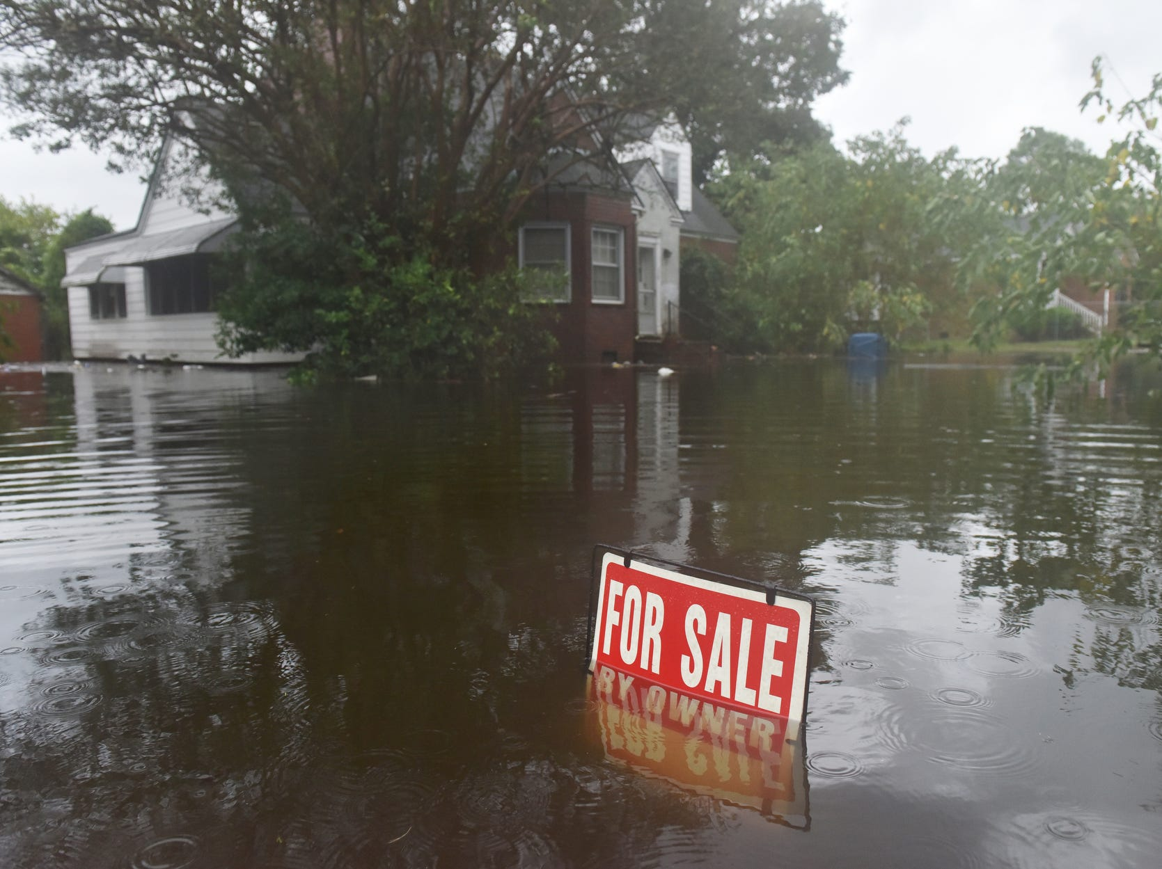 A home for sale sits in high water on W 6th St after Hurricane Florence brought heavy rains to Washington, N.C. on Friday.