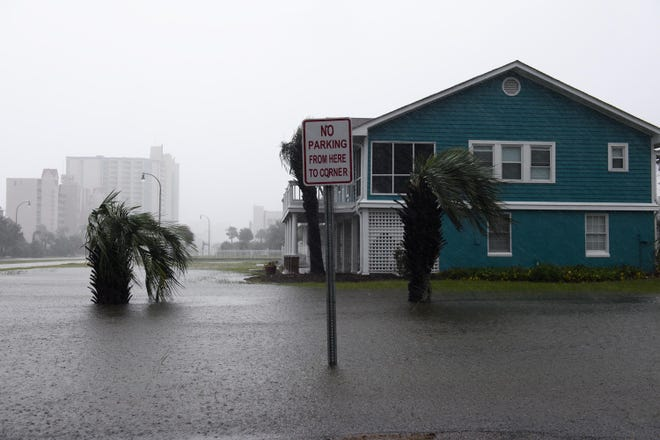 The yard of a home is flooded in the Cherry Grove neighborhood in North Myrtle Beach, S.C. on Saturday, Sept. 15, 2018.