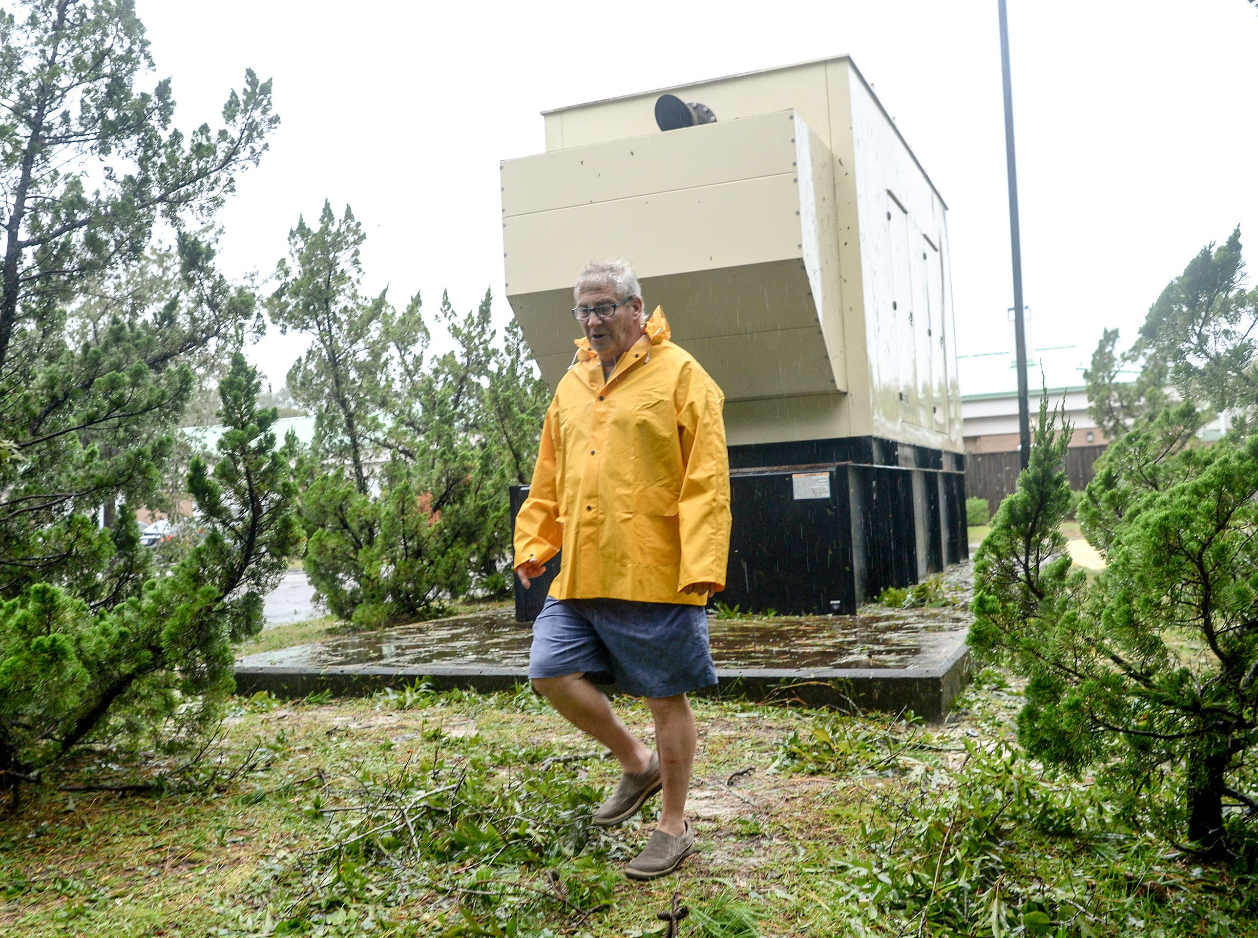 Jeff Winecoff, Facility Maintenance Administrator for The Davis Community, surveys damage from Florence around a generator which went down for 15 hours.